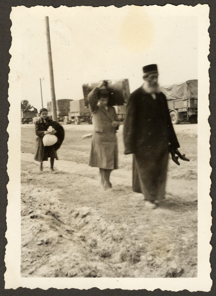 "Polish Jews flee on foot during the Invasion of Poland.   Original German caption read: ""Our darlings, how we met them on the advance up to Ostrow ."""