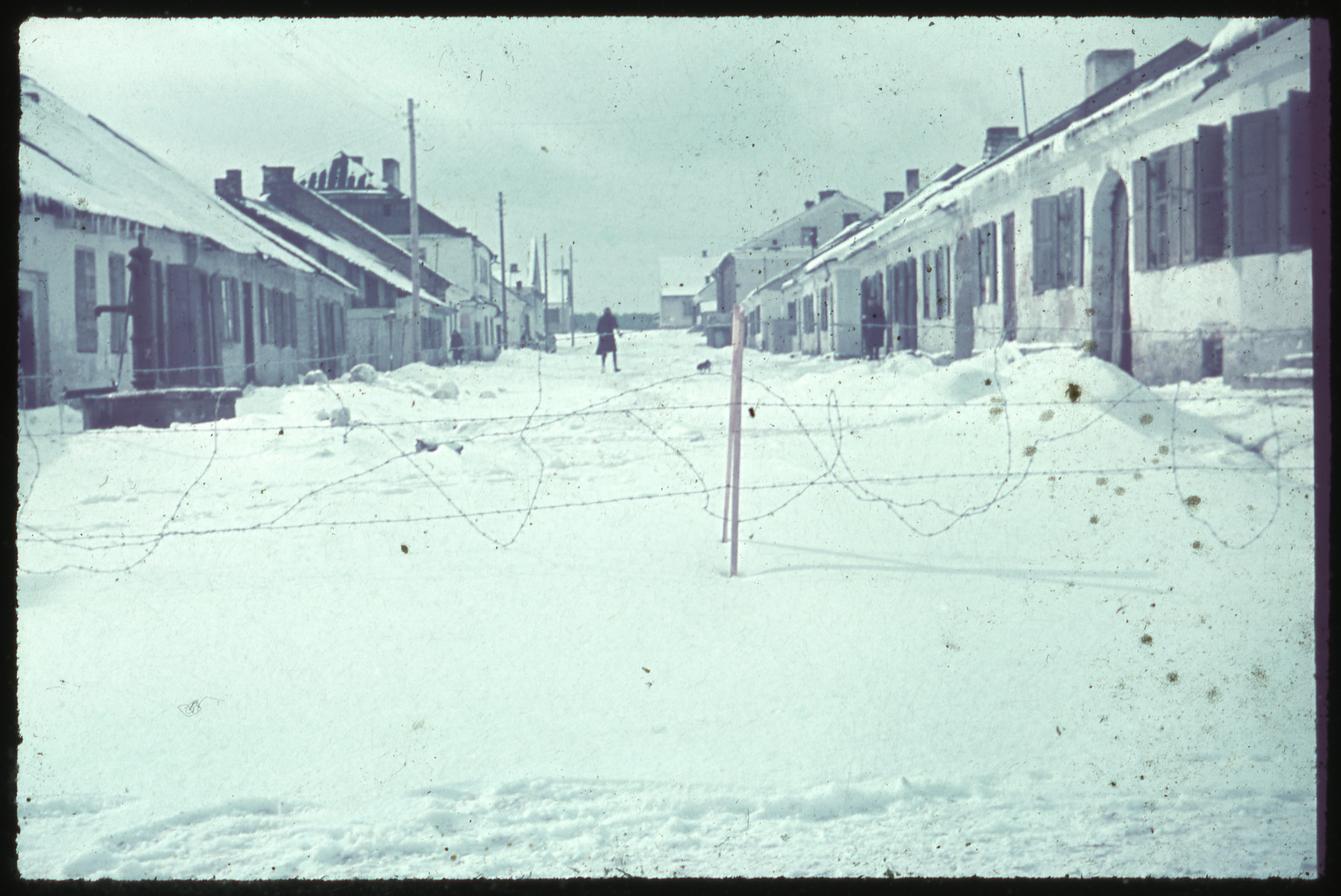 View of a nearly deserted snow covered street [probably Targowa Street] in Kozienice.