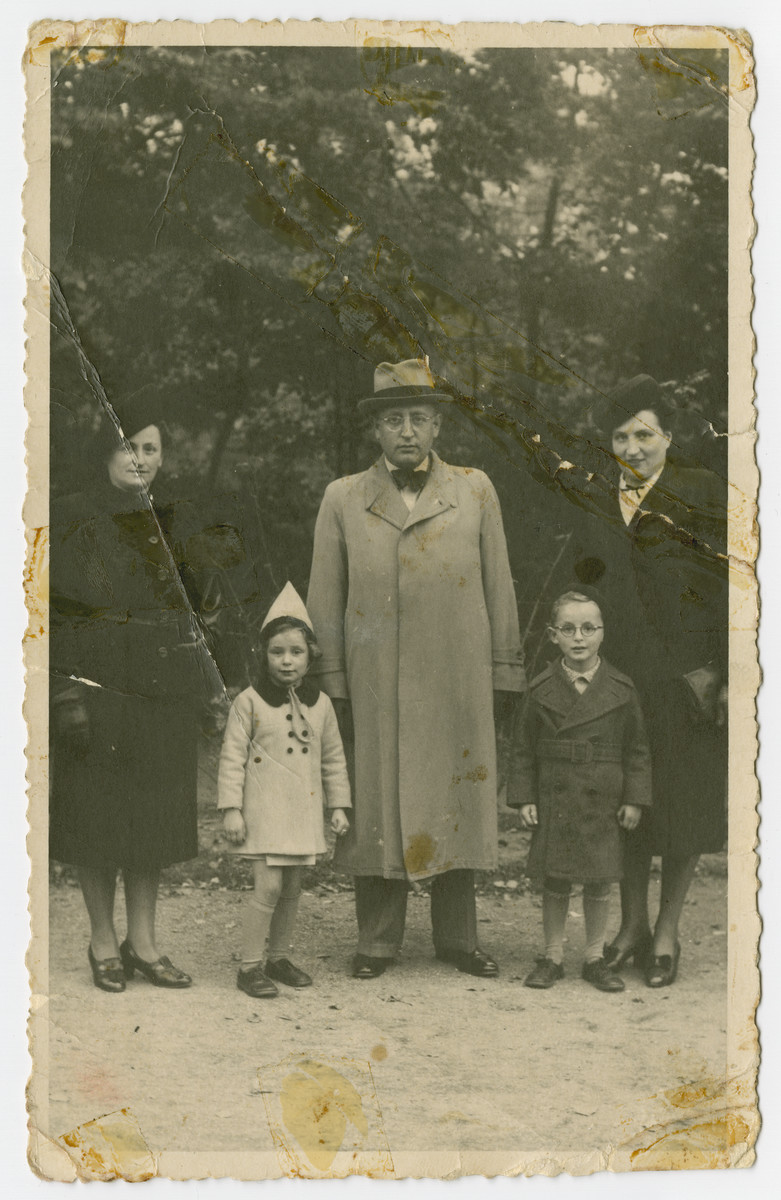 The Spielman family poses in a park either shortly before or shortly after the German invasion of the Netherlands.  Pictured from left to right are Helen Hudes Spielman, Hanna Spielman, Alexandder Spielman, Nathan Spielman and Mira Spielman (Alexander's sister).