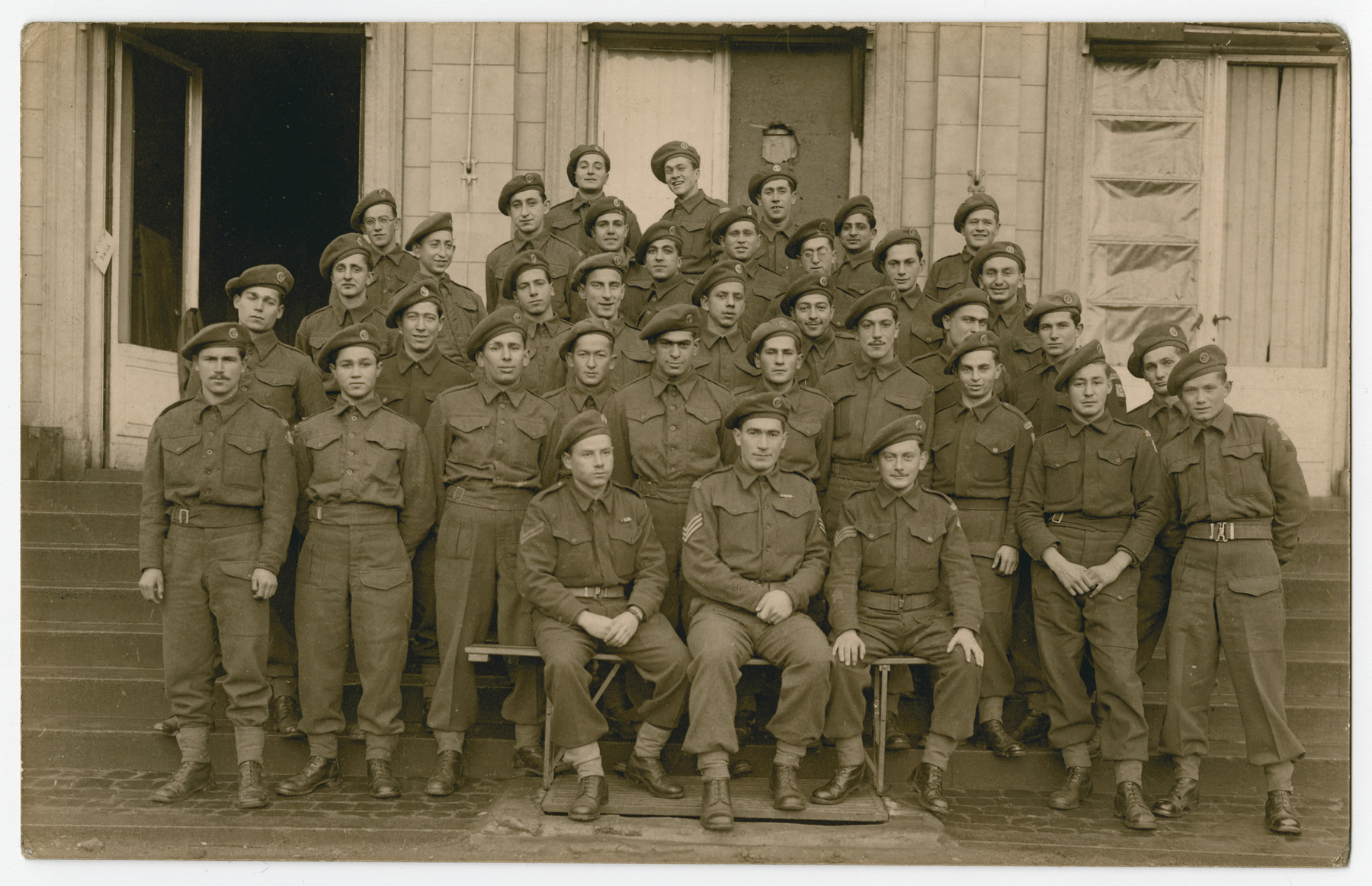 Group portrait of the members of the Third Battalion, Company A of the Jewish Brigade at their headquarters in Antwerp.  Among those pictured are Hersh Makowski, Eric Gross, Werner Szerevski and Zrubavel Horowitz.