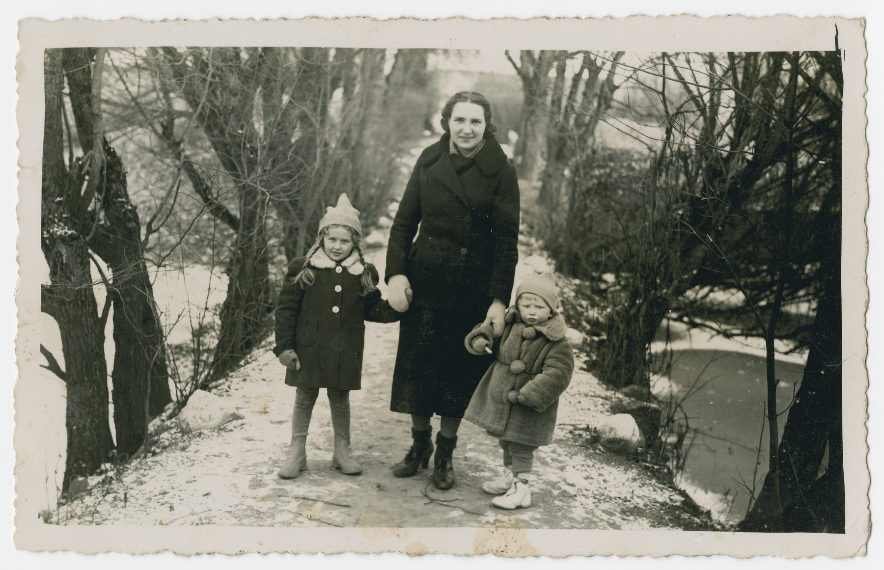 A mother walks with her two children in a park in prewar Butrimonys.  Part of a collection of photographs depicting Jews from Butrimonys where some 750 Jews were rounded up and murdered by the Einsatzgruppen and Lithuanian collaborators after the invasion of the USSR.