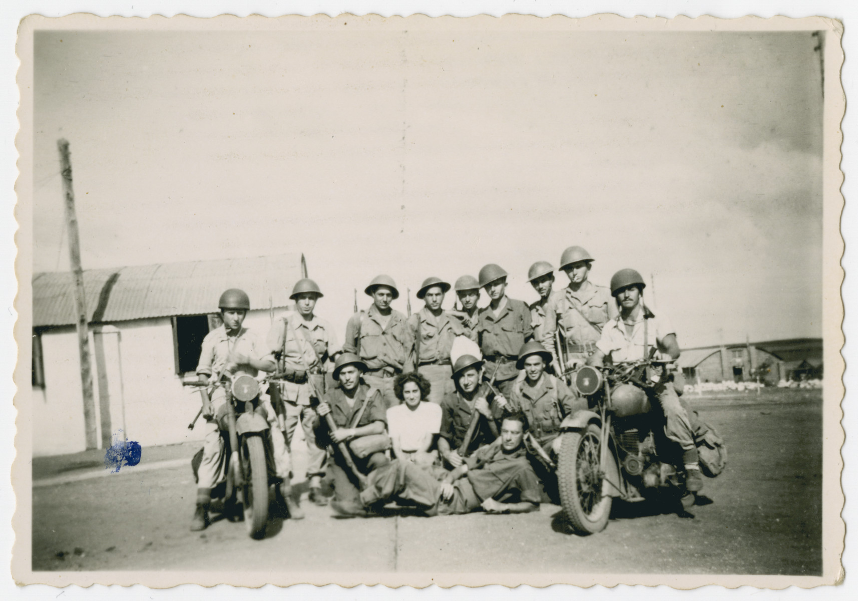 Group portrait of members of the Alexandroni Brigade.  Among those pictured is Hersh Makowski.
