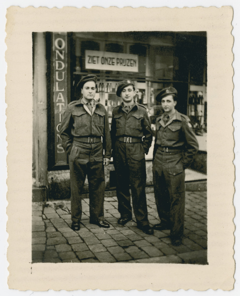 Three Jewish Brigade soldiers, all former Mauritius internees, stand outside a store in Eindhoven.  Pictured left to right are Eric Gross, Hersh Makowski and Werner Szerevski.