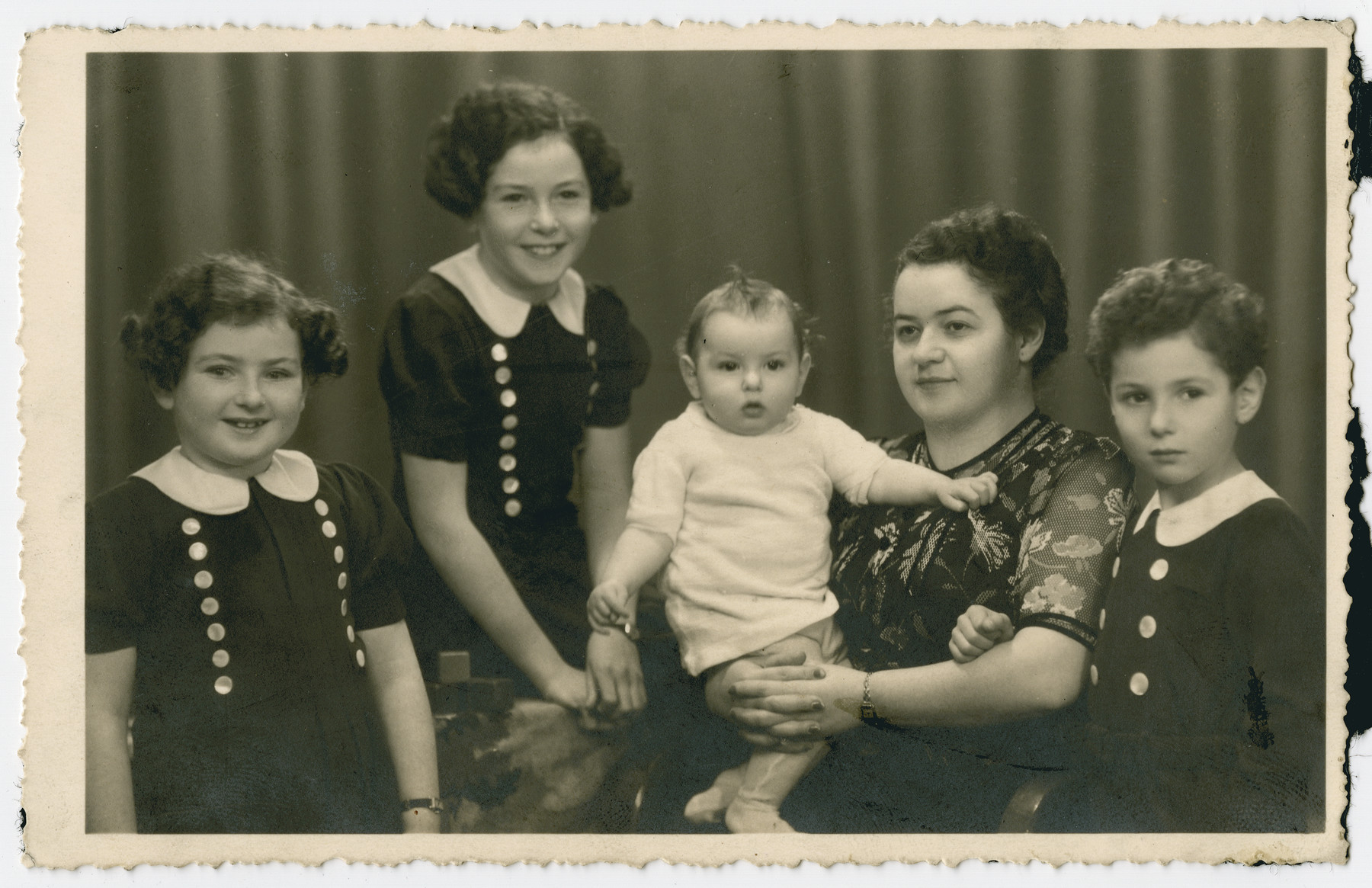 Studio portrait of the wife and children of Michael (Max) Weiss, exact date and locale unknown.  Pictured from left to right are Edith, Regina, Hanna, Helen and Henry Weiss.