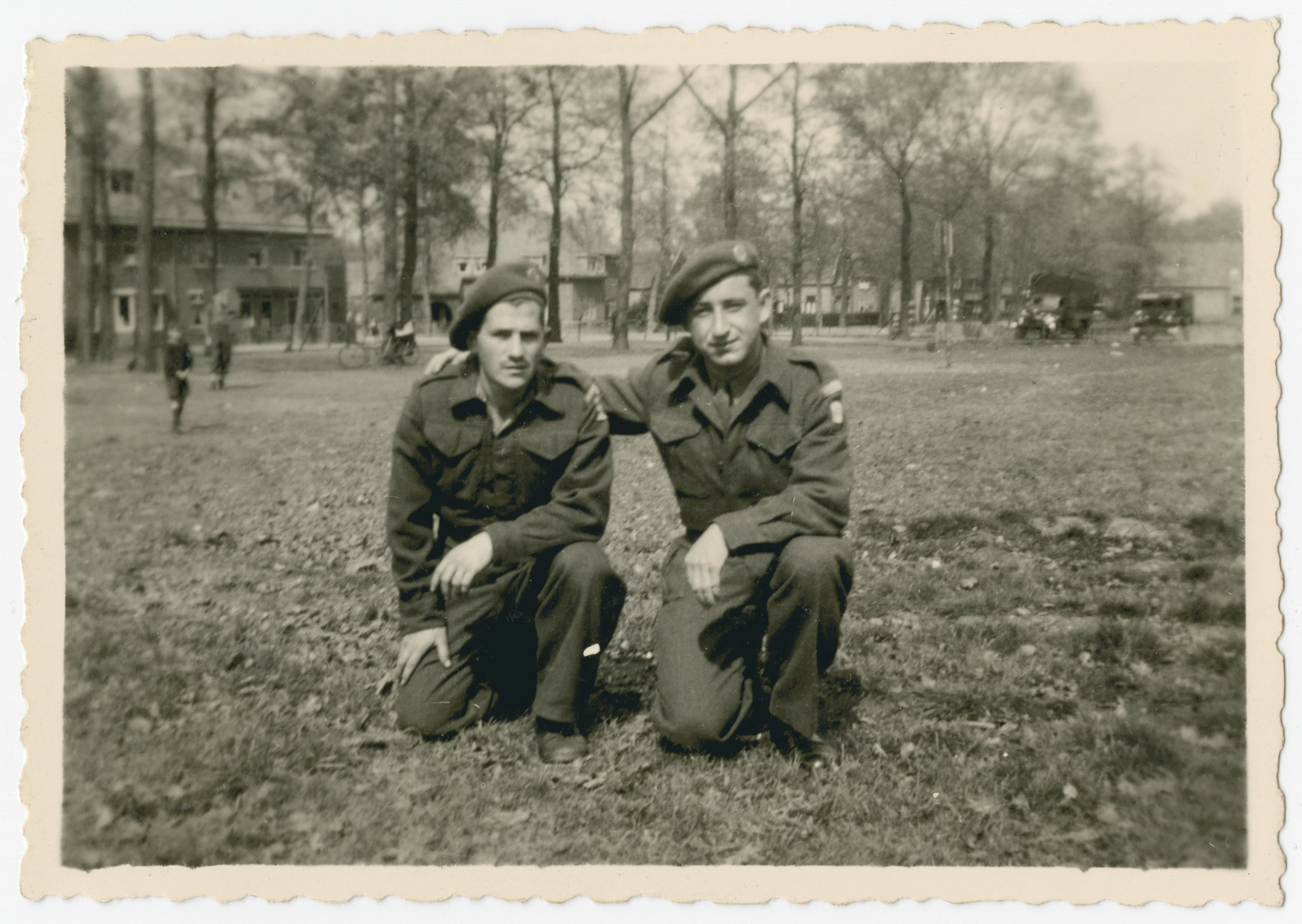 Two Jewish Brigade soldiers pose together on a grassy field in Eindhoven.  Pictured are Zrubavel Horowitz and Hersh Makowski.  Zrubavel Horowitz (b. 1924, Lithuania) became a lieutenant in the Palmach.  He was killed in action while escorting a convoy to Jerusalem during the Israeli War of Independence.