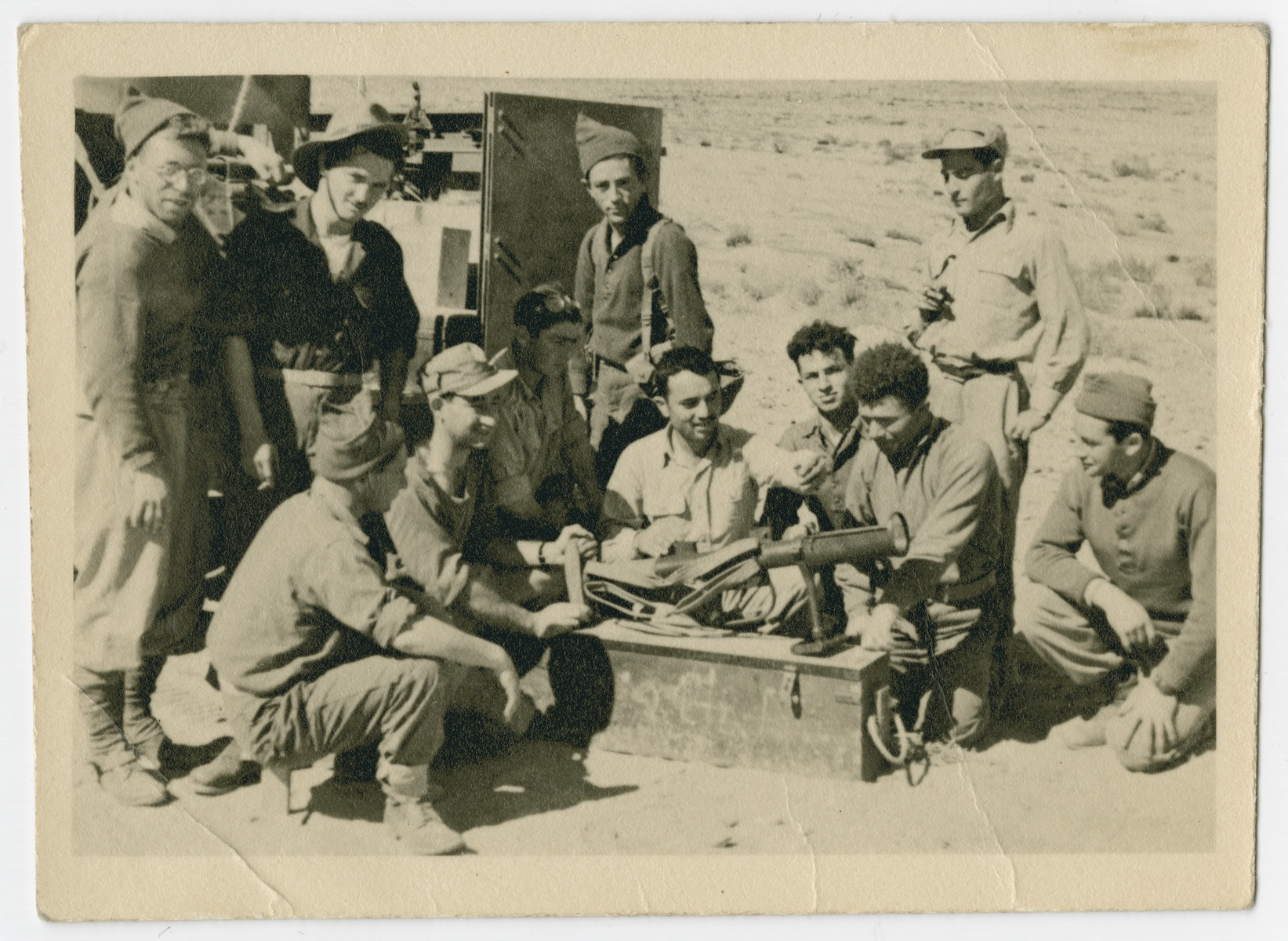 Hersh Makowski demonstrates to other soldiers in the Alexandroni Brigade how to use a British anti-tank weapon.  He was the only member of his brigade to have received training by the British Army.