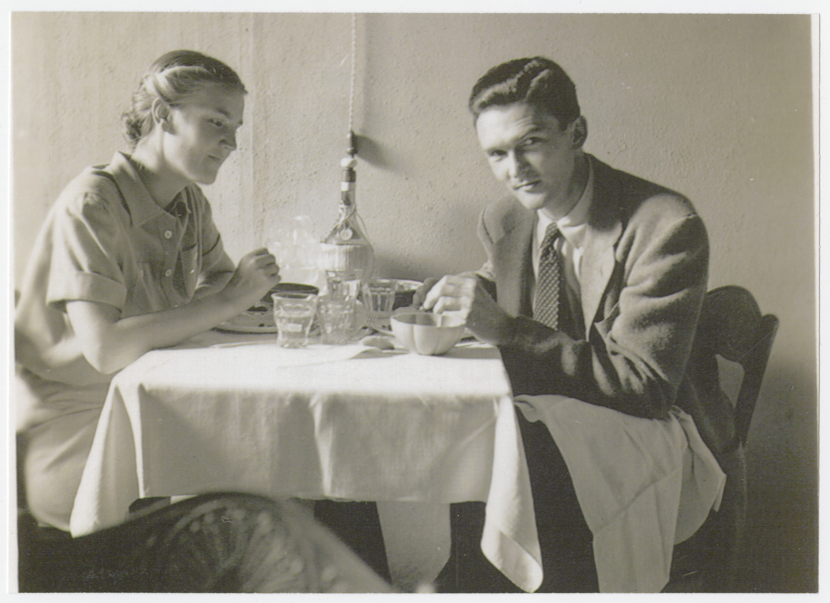 Roswell and Marjorie McClelland sit for a meal in Rome where they were opening an American Friends Service Committee Office.