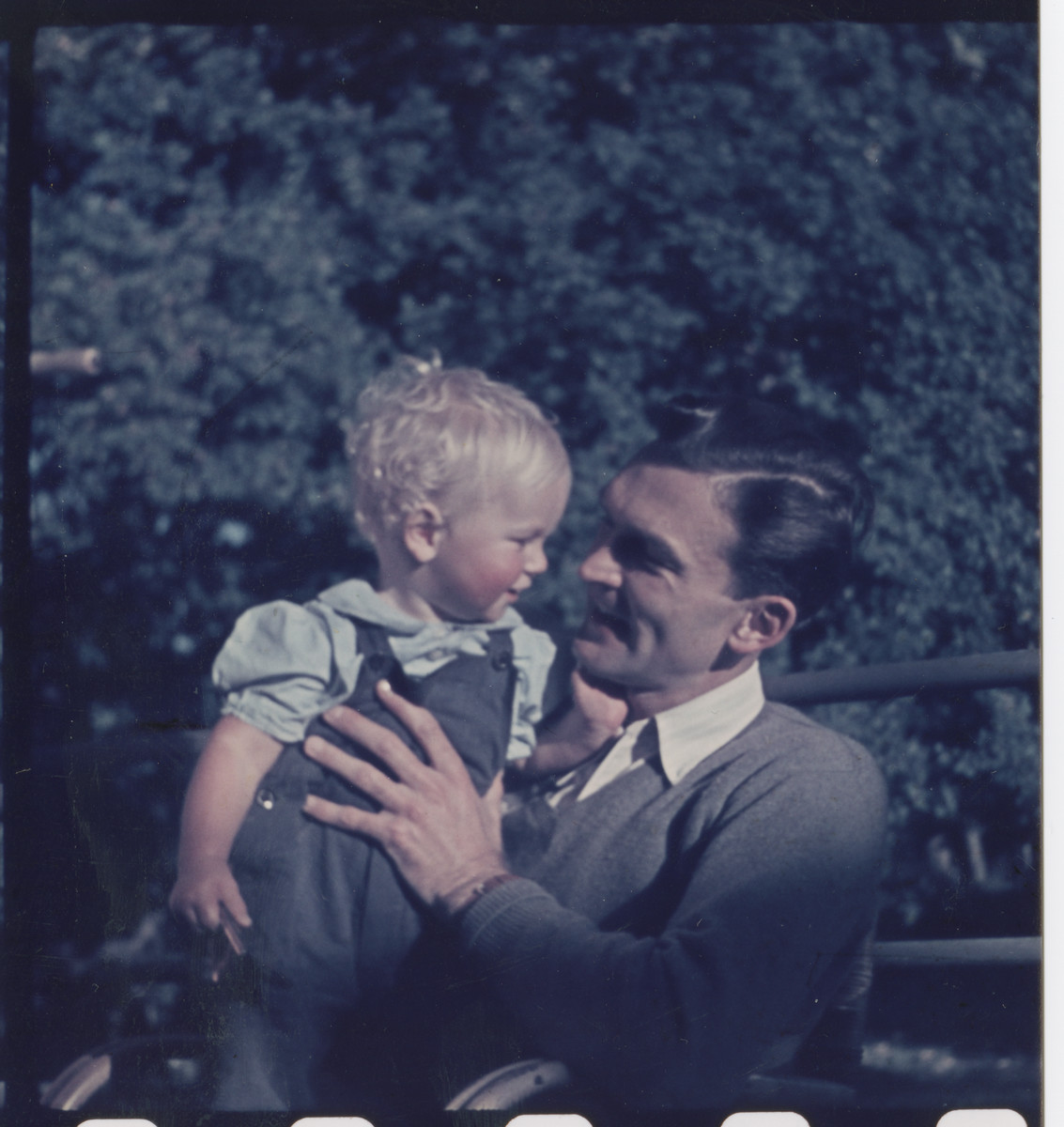 Roswell McClelland holds his baby son Kirk.