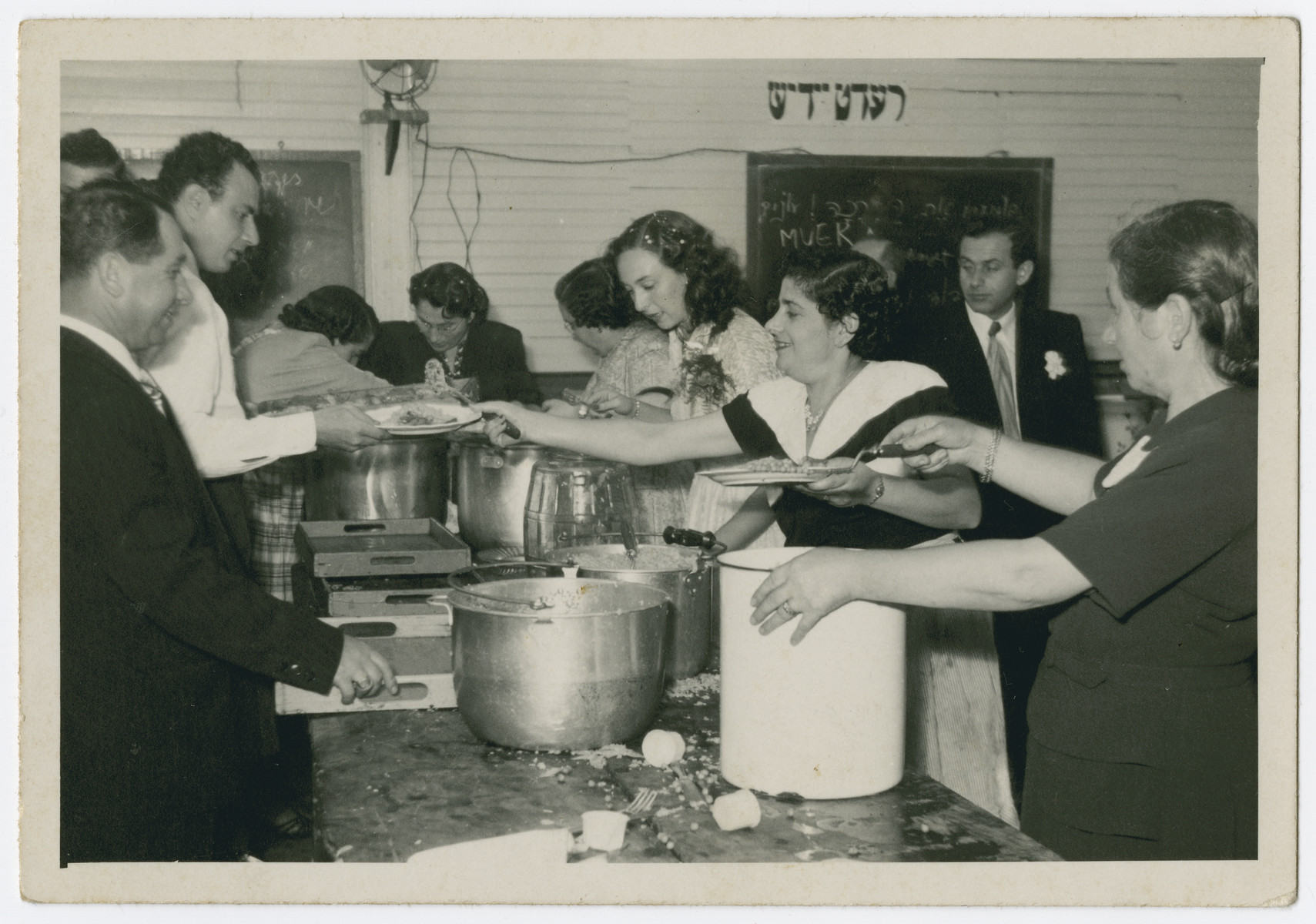 Jewish immigrants to Costa Rica prepare the food for a wedding of survivors from Zelechow.  Pictured are Sara Ickowicz, David Finesilver ( a survivor of Majdanek) and Sara Goldberg.