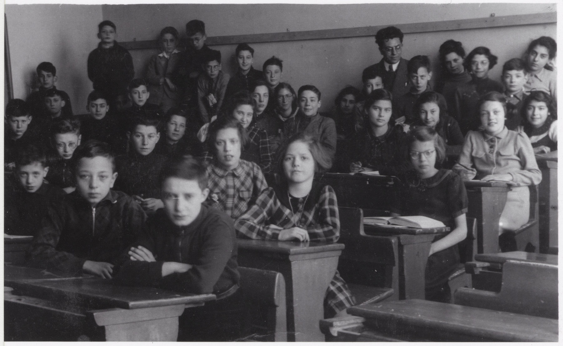 Students in a classroom in Utrecht, including a handful of Jewish students.    Among those pictured is Karin Joshua.  The Joshua children attended the school for a few months before all the Jewish students were expelled.  Afterwards they attended a Jewish school.
