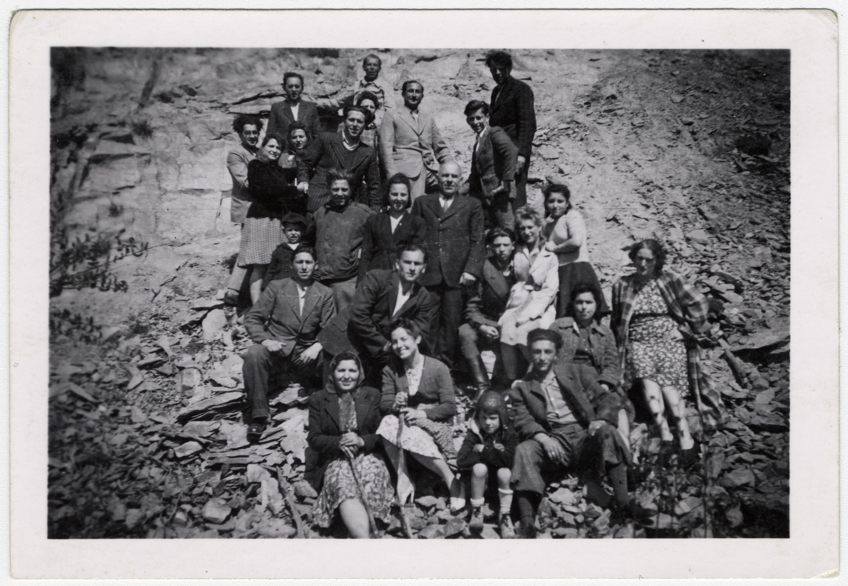 Former Zhetel partisans go on a picnic shortly after liberation.  Sonia Minuskin is on the borrom left.  Her son Henikel is sitting in the front wearing shorts.
