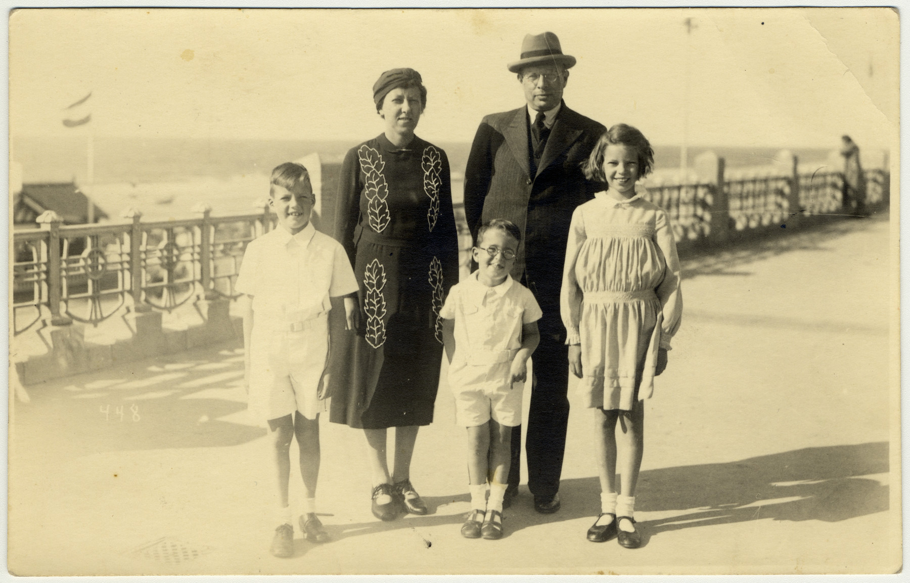 The Joshua family walks by the beach in Scheveningen where they had fled from Germany.  From left to right are Jacob, Elisabeth, Henry, Max and Karin Joshua.