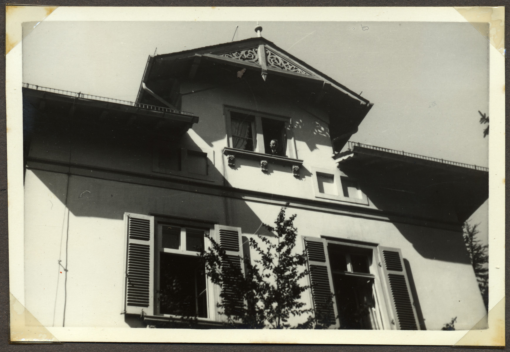 Hans Ehrenfeld looks out the top window of his home at Stettenstrasse 4, in Frankfurt.