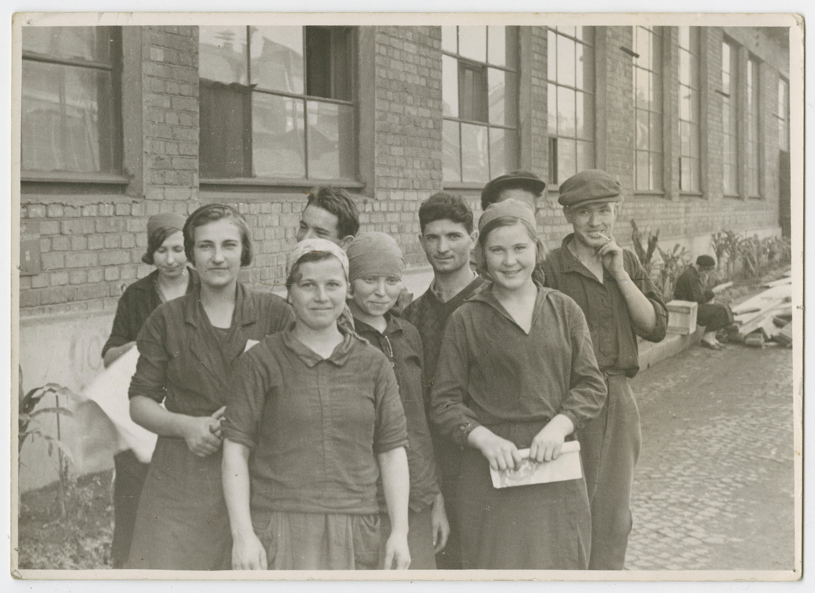 "Group portrait of young workers in a Soviet collective, [possibly in Birobidzhan].  Photograph is used on page 345 of Robert Gessner's ""Some of My Best Friends are Jews."""