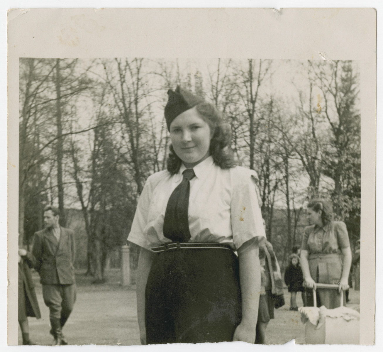 Lenke Gruenberg poses in her Betar uniform outside the Deggendorf displaced persons camp.