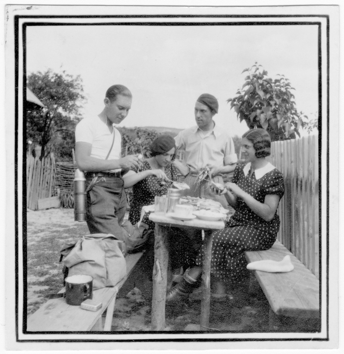 Four Romanian Jewish youth prepare a picnic.  Among those pictured are Anna and Miriam Segal.