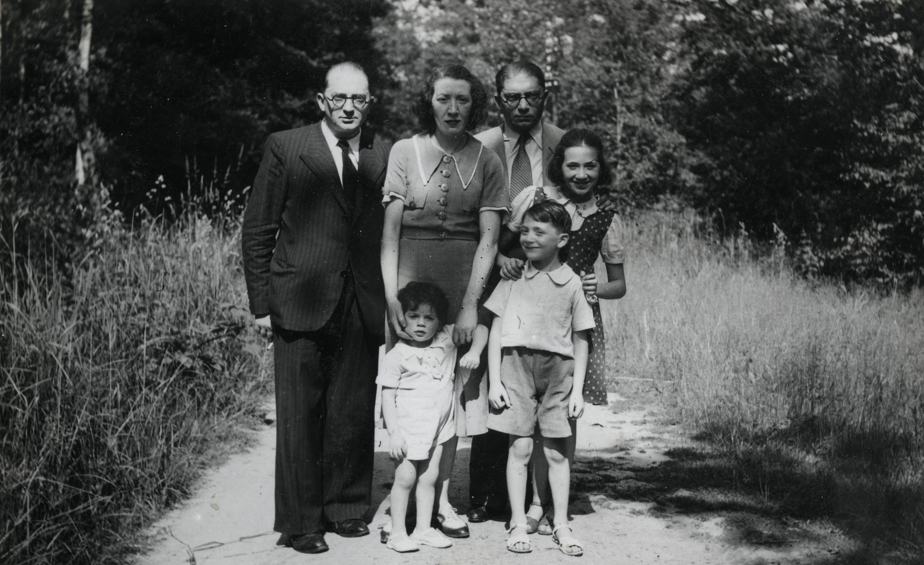 The Spira family visits Taverny shortly after the German invasion.  From left to right are Eduard, Camille and Joseph (Eduard's brother) Spira with Robert, Max and Annie in front of them.