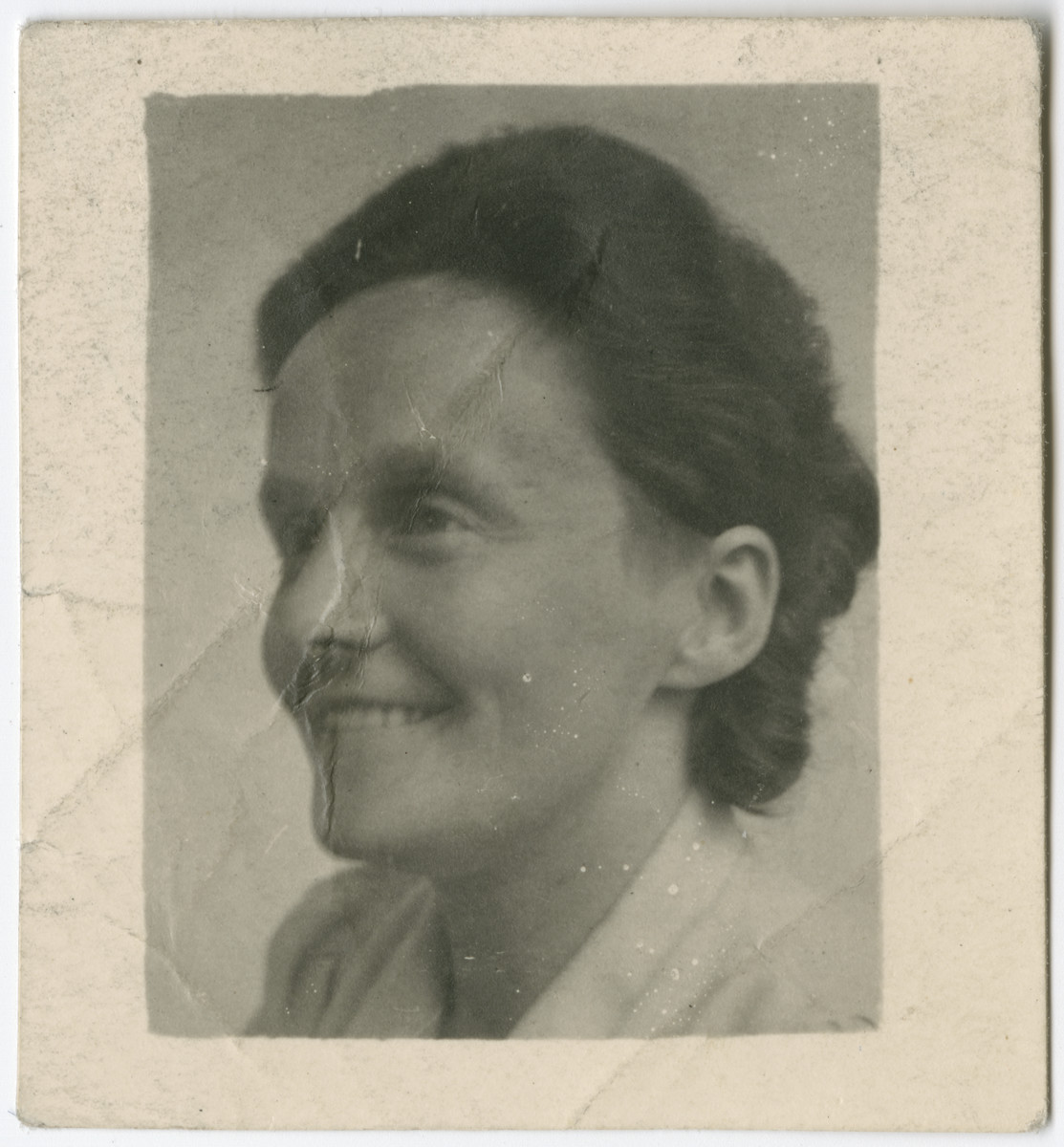 Portrait of Anne Onderweegs used on her false ID card.   Anne and Dick Onderweegs were members of the resistance in the Netherlands, where they assisted Jews in hiding. These IDs were created to help them escape detection after they were denounced and sought for arrest. The Onderweegs resuced Louis de Groot.