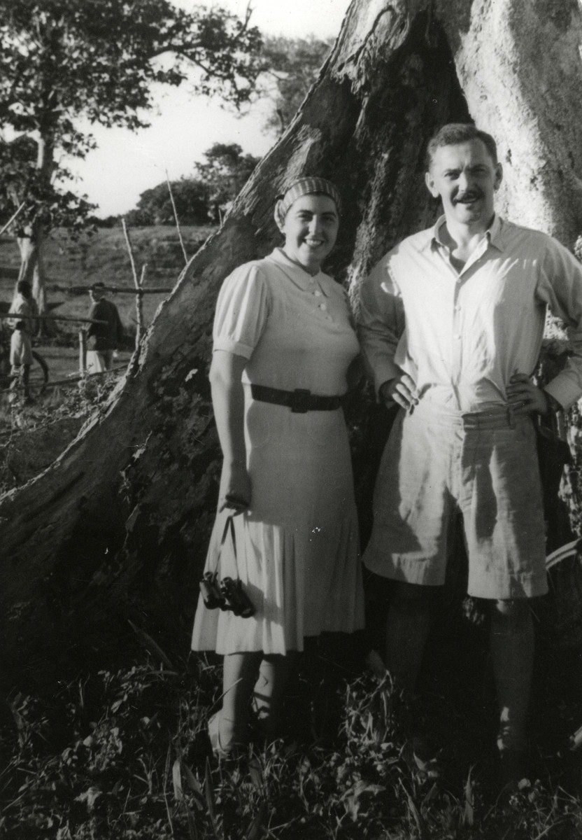 Walter and Katja Loebl (cousins of the donor) pose beneath a tree in Kampala, Uganda.  They had lived in Africa since the mid 1920's.