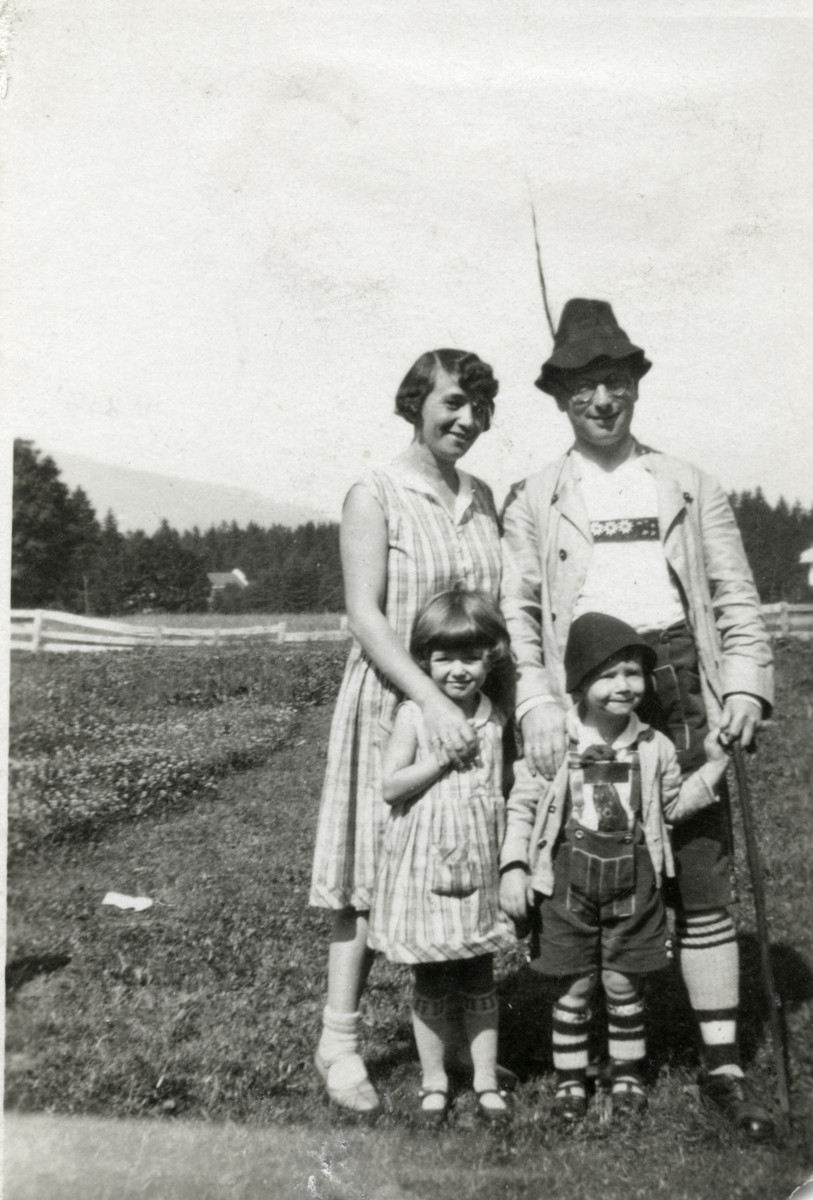 The Loebl family goes hiking dressed in traditional Bavarian clothing.  Pictured are Frieda and Sally Loebl and their children Erika and Werner.