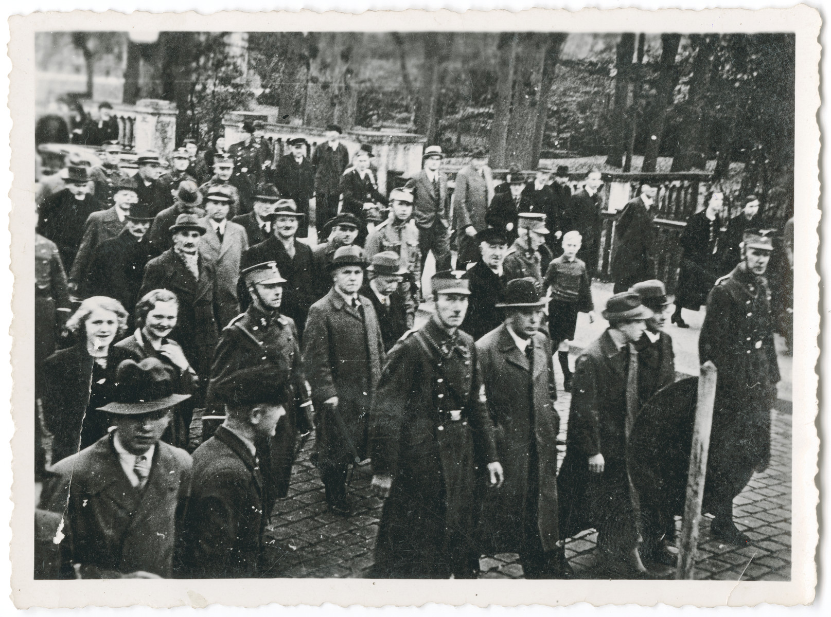 "Members of the SA arrest Jewish men from Oldenburg and march them through the streets as bystanders look on.  Among those pictured is the great grandfather of the donor, Adolf Daniel de-Beer.  The orignal caption reads: ""SA arrest and transport the Jews of Oldenburg to prison and concentration camp.  Part of a series of ten photographs."""