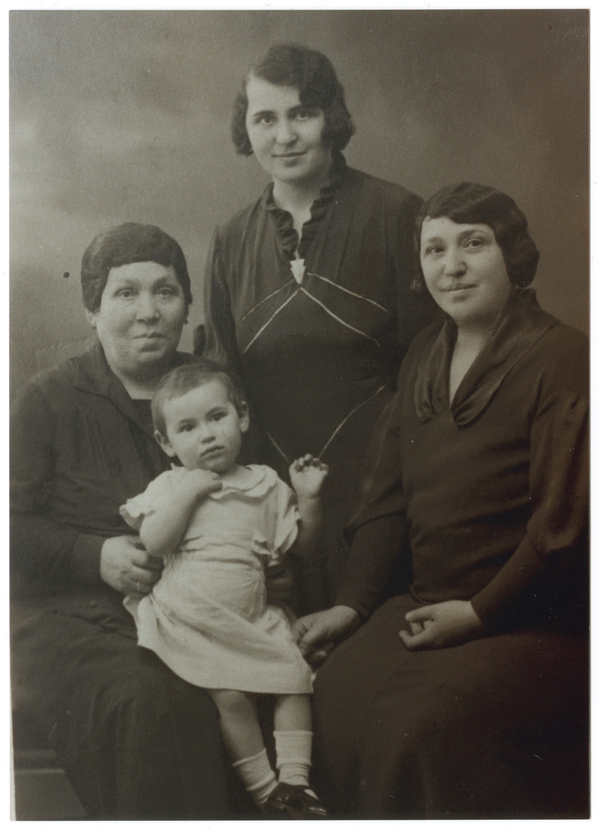 Studio portrait of four generations of the women of the Ksias family.  Pictured are great-grandmother Leah, grandmother Sara Ksias, mother Dora Ksias Teitelbaum, and Bertha Teitelbaum, age 2.