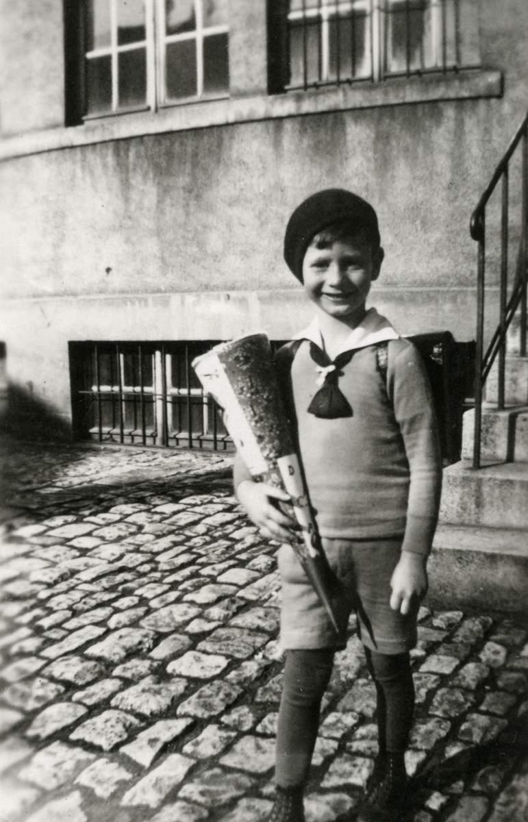 Werner Loebl holds a cone of goodies on his first day of school.