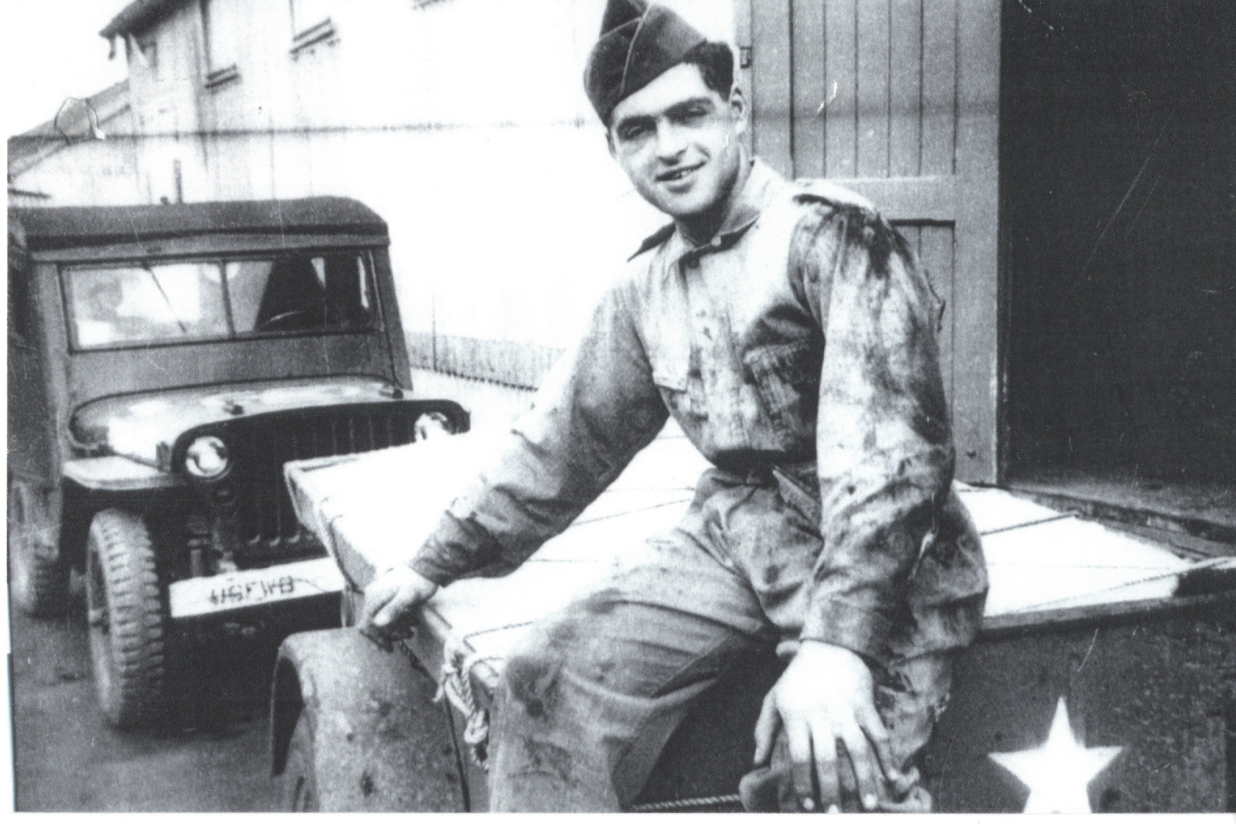 David Marcus seated on a military vehicle.