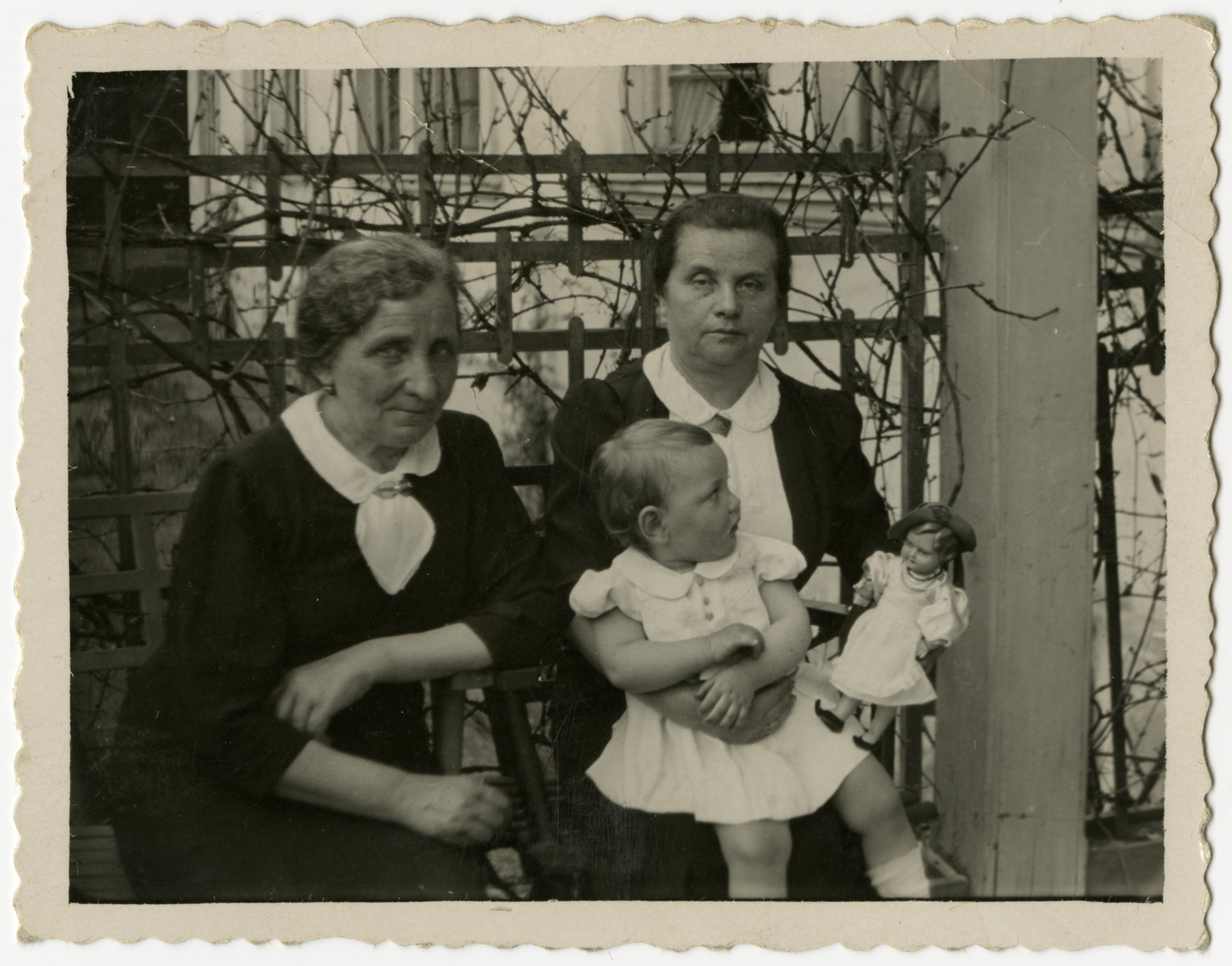 Helen Sznajderman poses with her two grandmothers.  From left to right are Regina Szymin, Helen and Chana Sznajderman.