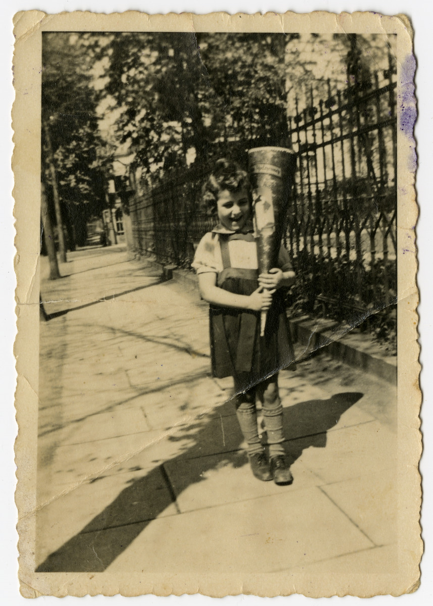 Susi Hilsenrach poses with a cone of sweets on her first day of school.