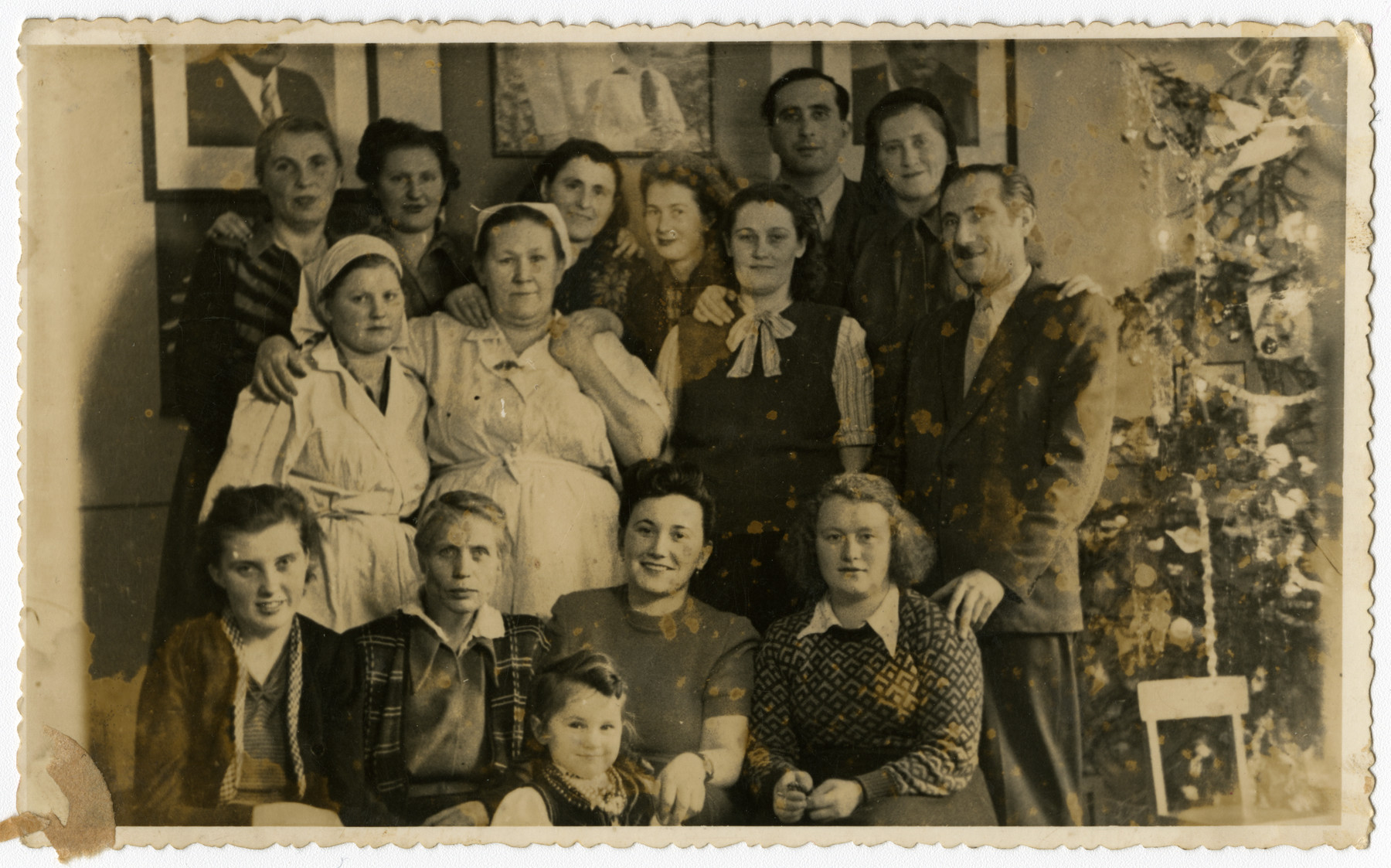 Staff members of a Jewish kindergarten in Szczecin after the war.   Pictured third from left in the front row is Klara Gorysznik-Meszel with her daughter Roza.
