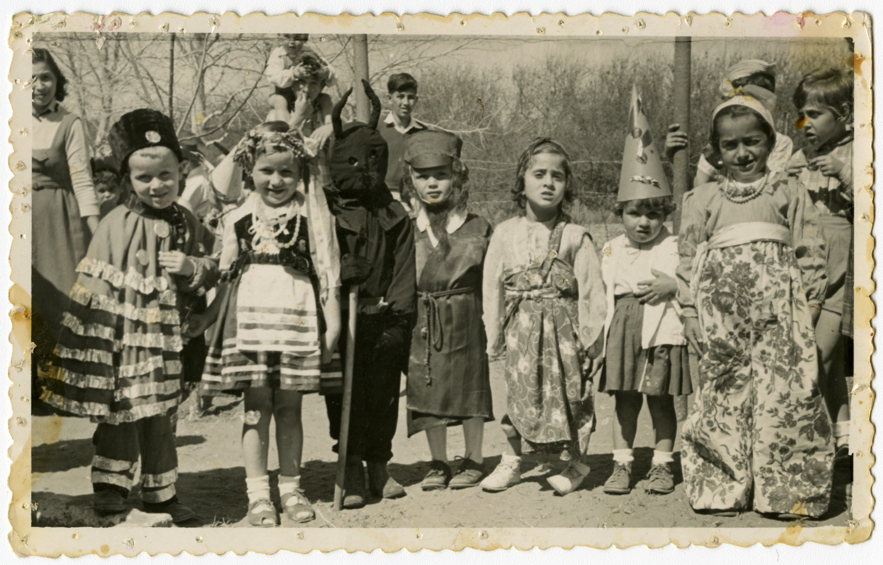 Group portrait of Jewish children wearing costumes [probaly for a Purim celebration].