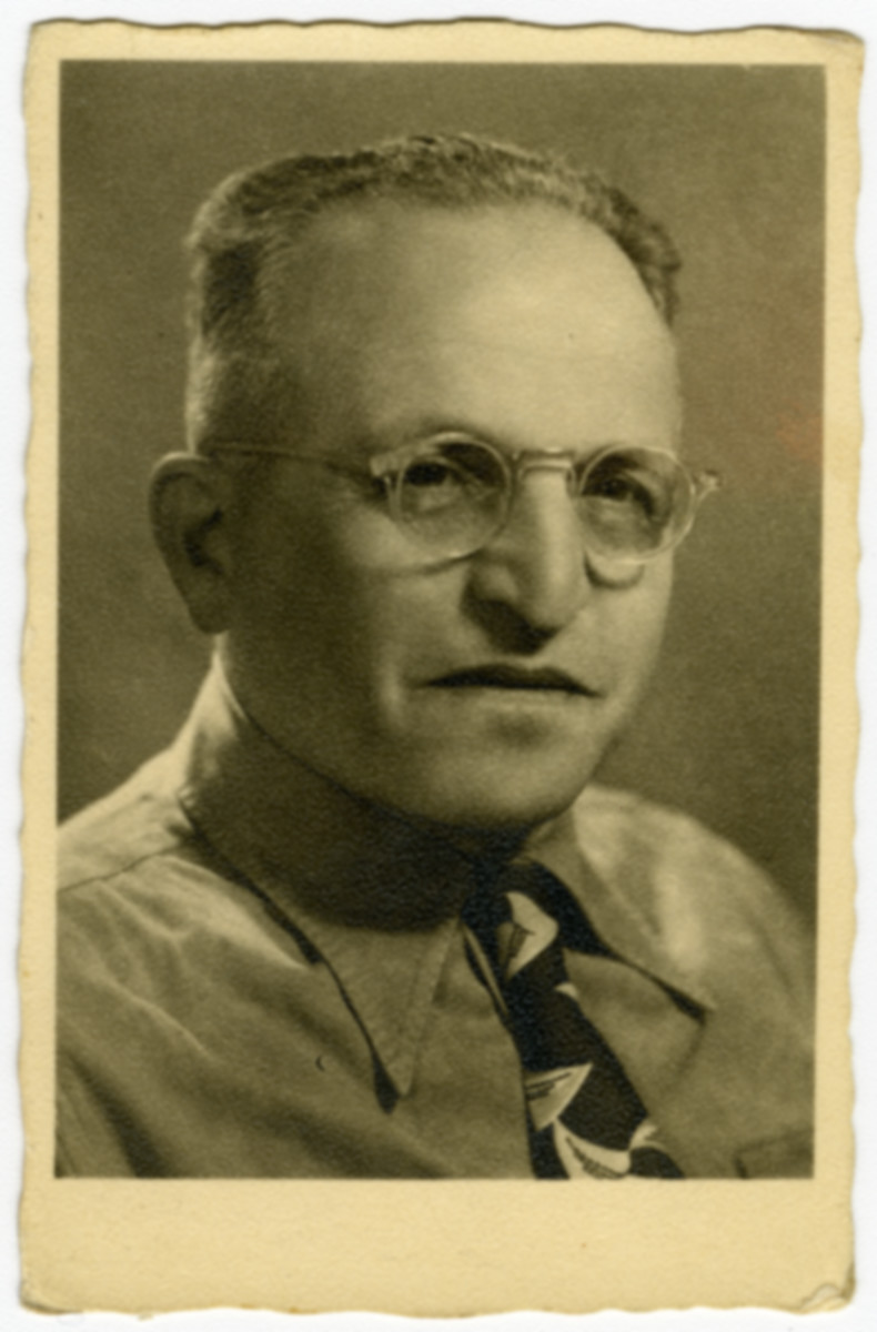Studio portrait of Lajos Ornstein taken on the third anniversary of his arrival in Israel.
