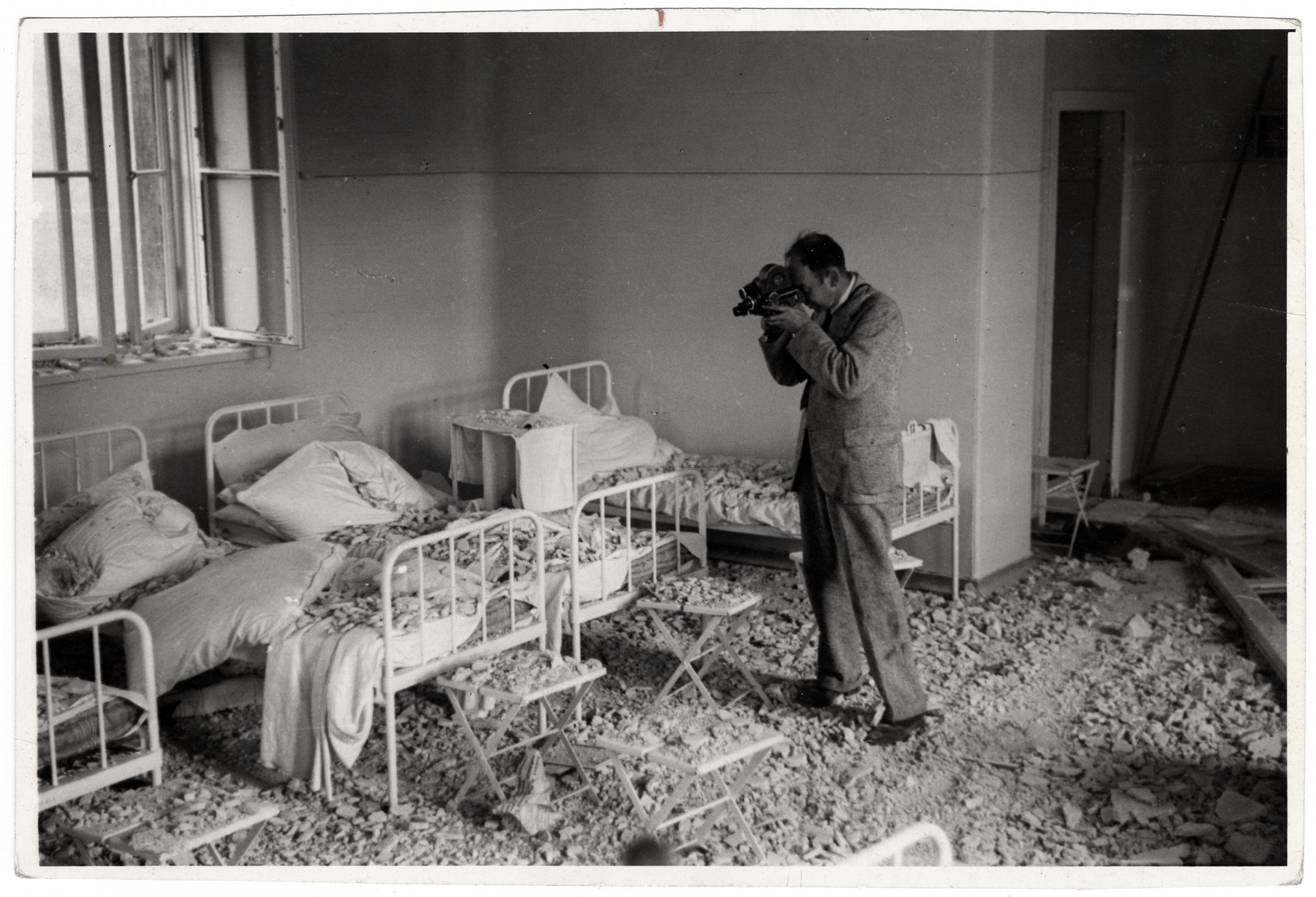Film maker and photographer Julien Bryan films the destruction of one of Warsaw's largest hospitals: the Catholic Hospital of the Transfiguration.