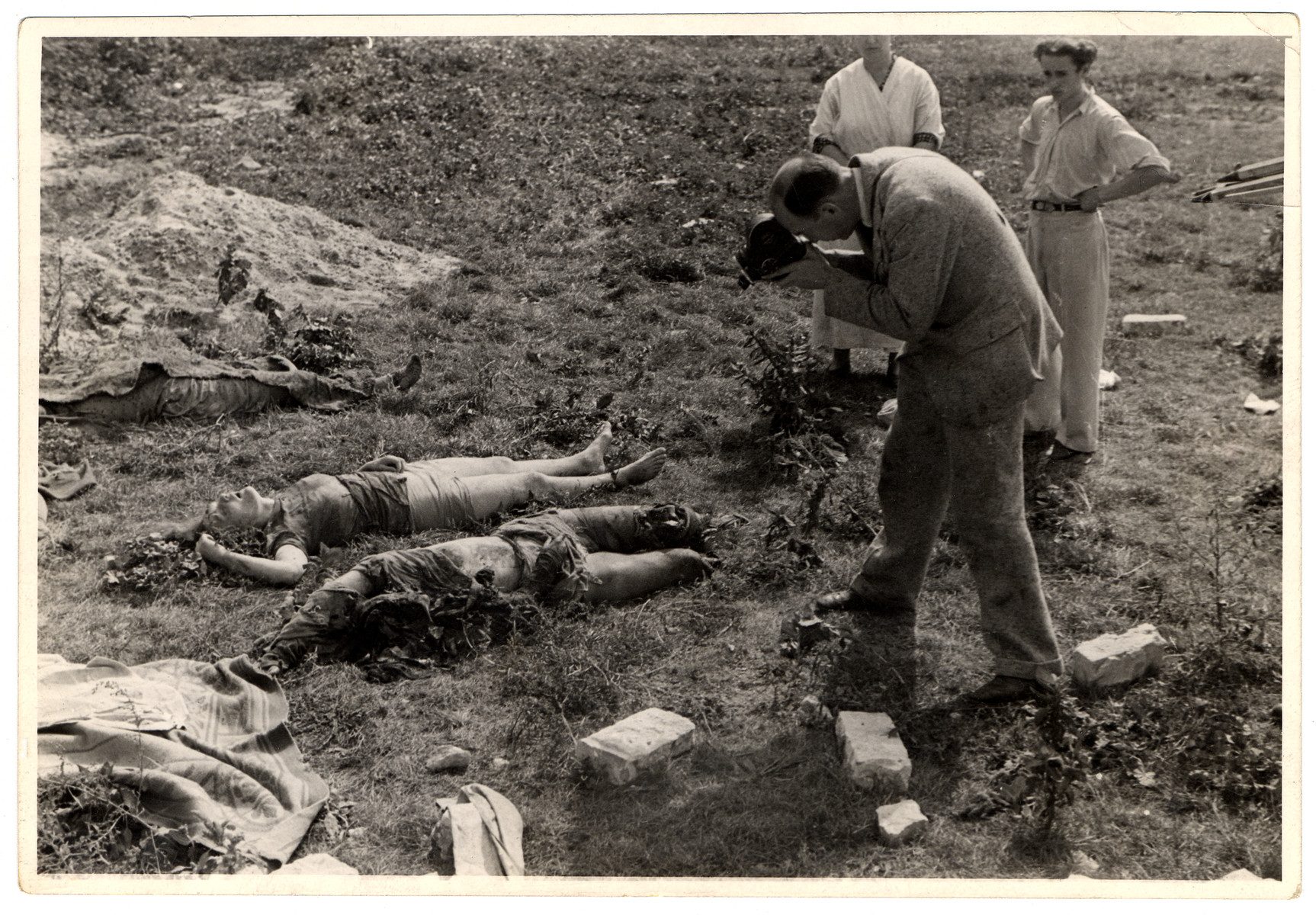 Photographer and filmaker Julien Bryan takes pictures of corpses during the siege of Warsaw.