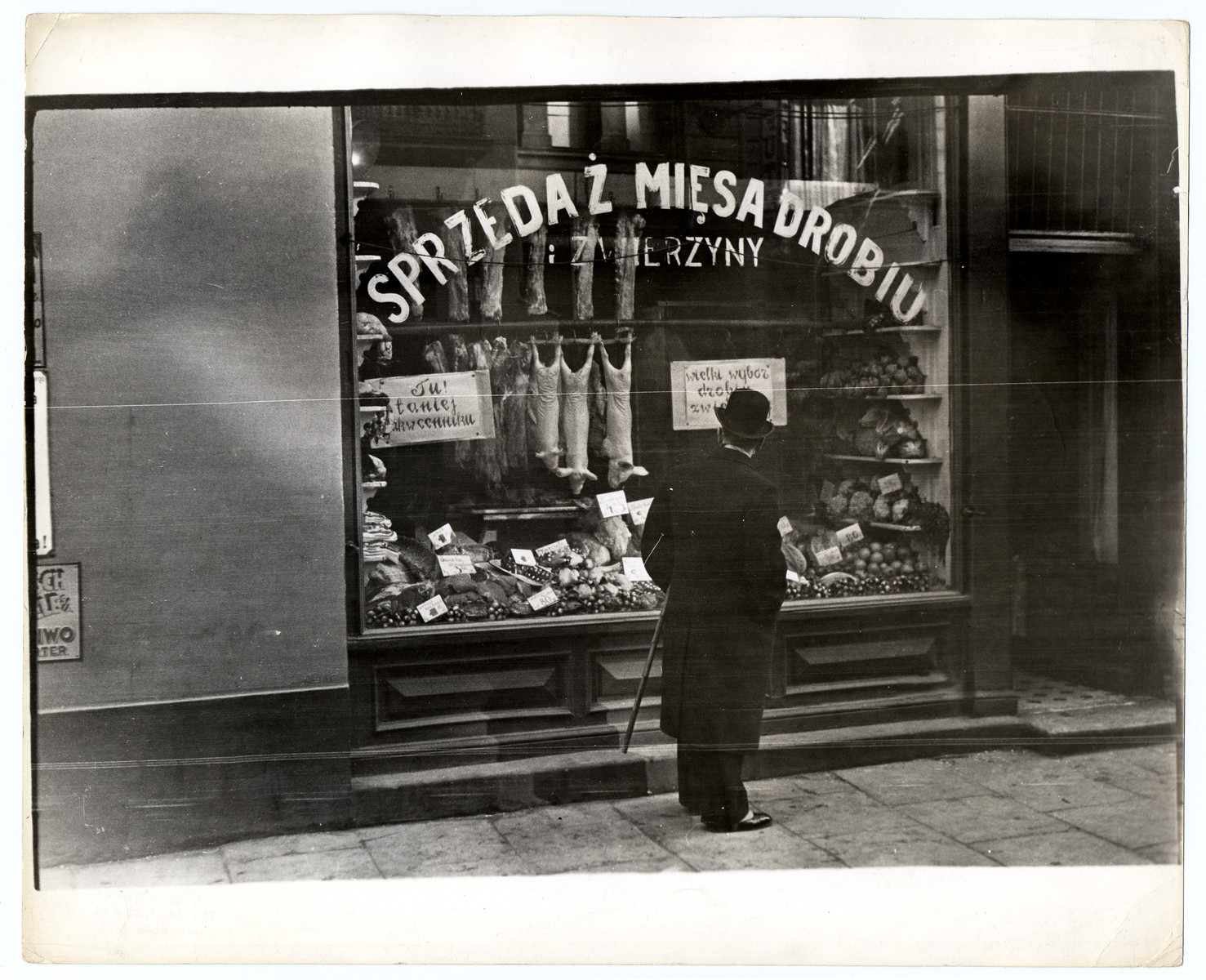 A Polish man peers into the window of a butcher's shop in Warsaw.