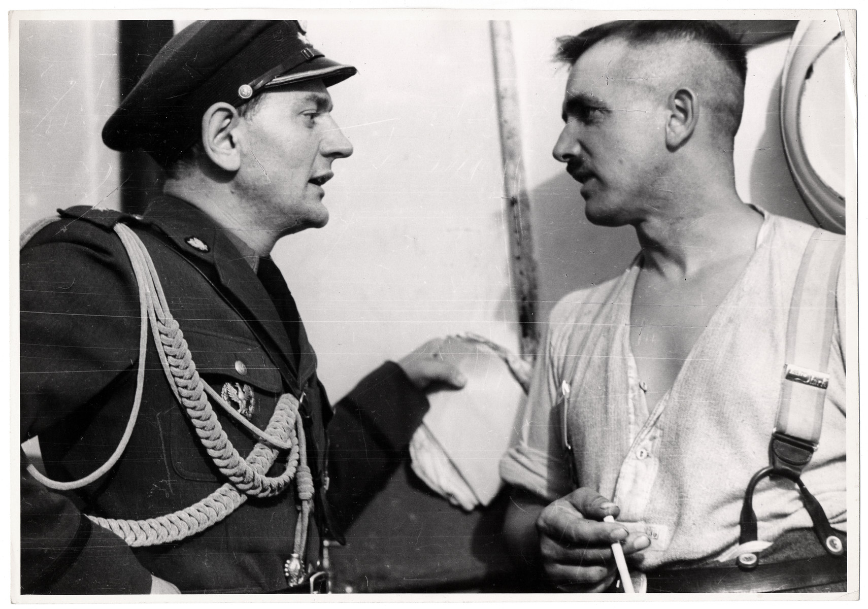 A Polish captain questions a German prisoner from East Prussia.