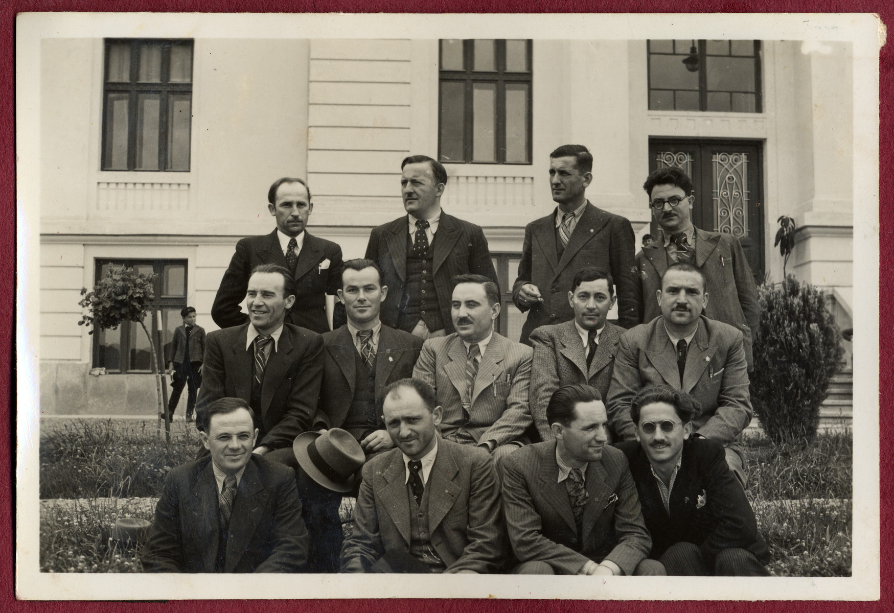 Jevrem Dragojevic, f(irst row seated second from the left)poses with other men before a municipal building in Visegrad, Yugoslavia.