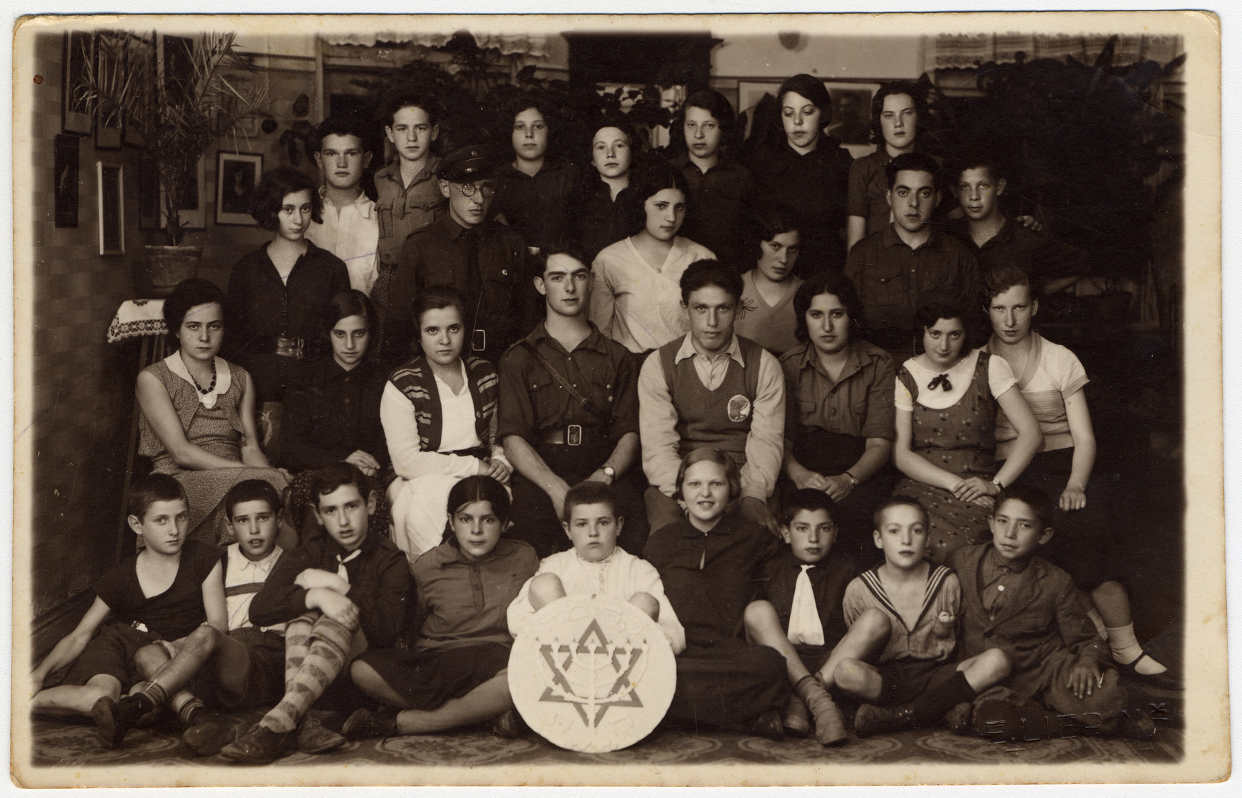 Group portrait of Jewish children and teenagers belonging to a Betar Zionist group in Latvia.