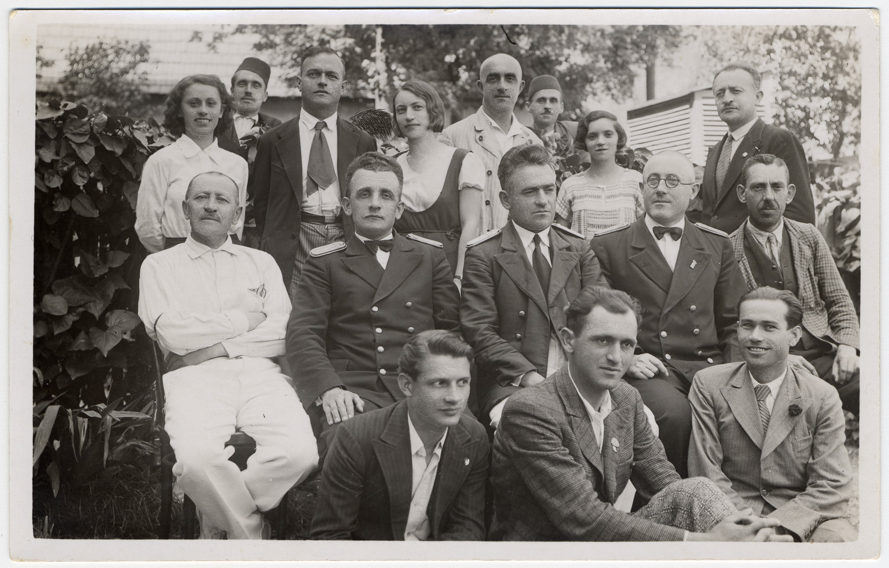 Jevrem Dragojevic (first row, center) poses with other community members in Visegrad, Yugoslavia.