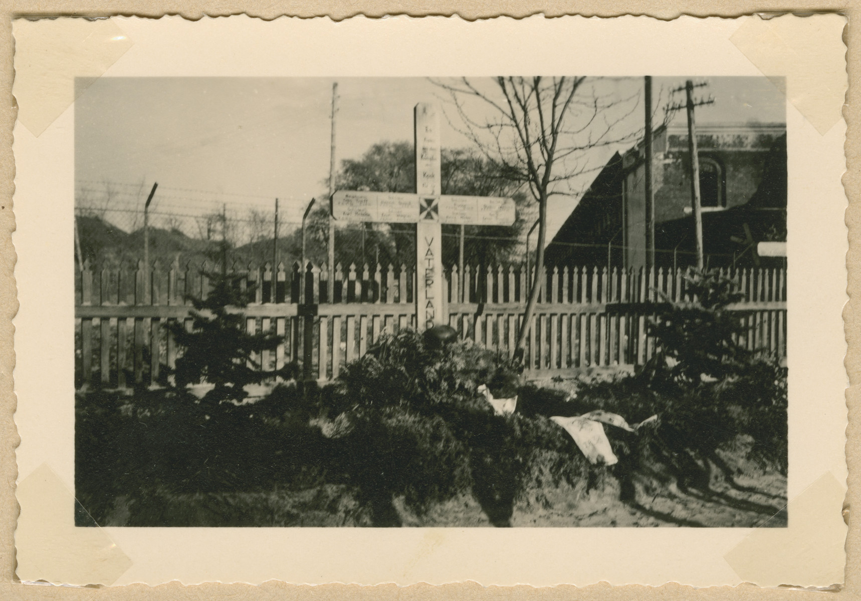 """View of a grave marker for a German soldier buried in Irena.  Written on the cross is the inscription """"Fatherland."""""""