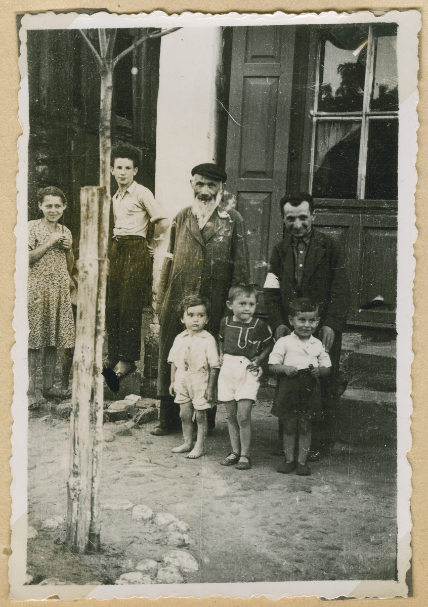 Jewish men and children pose outside a building in Deblin-Irena.