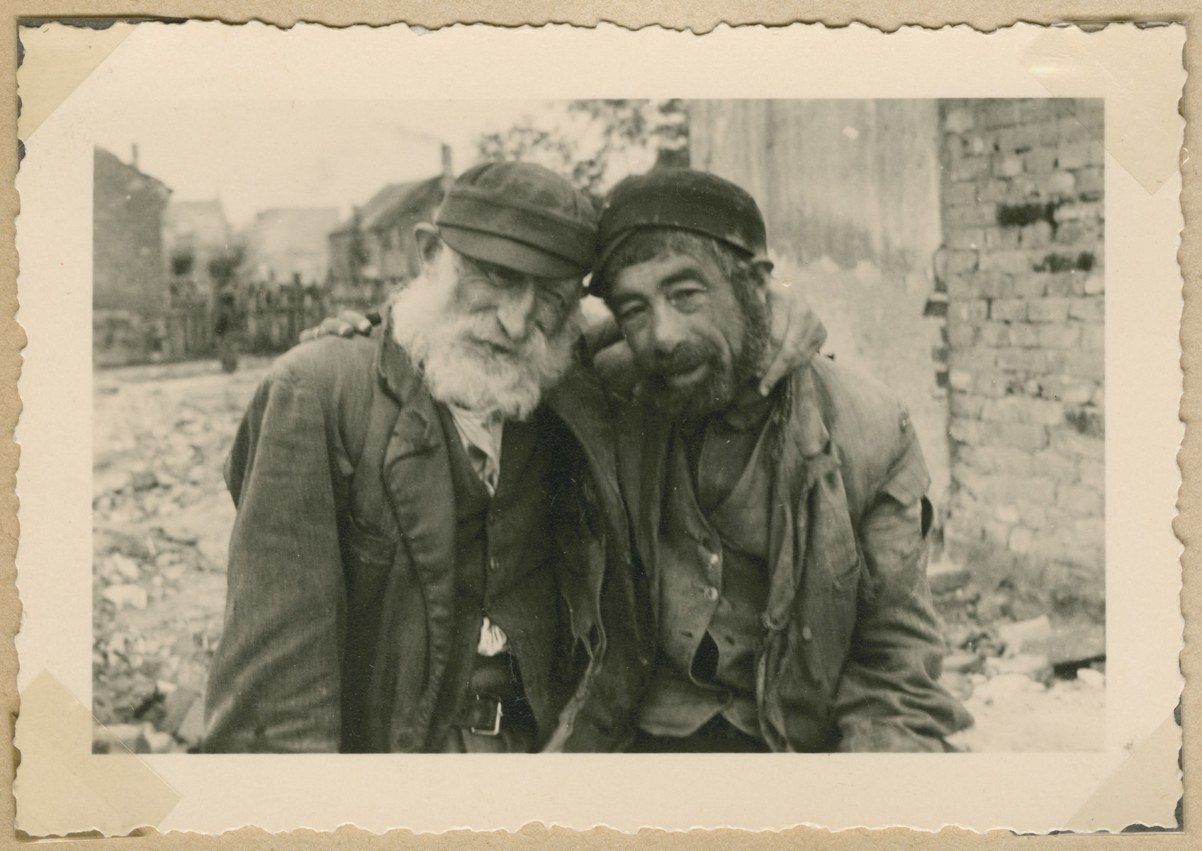 Close-up portrait of two Jewish men in what probably is the Deblin-Irena ghetto.