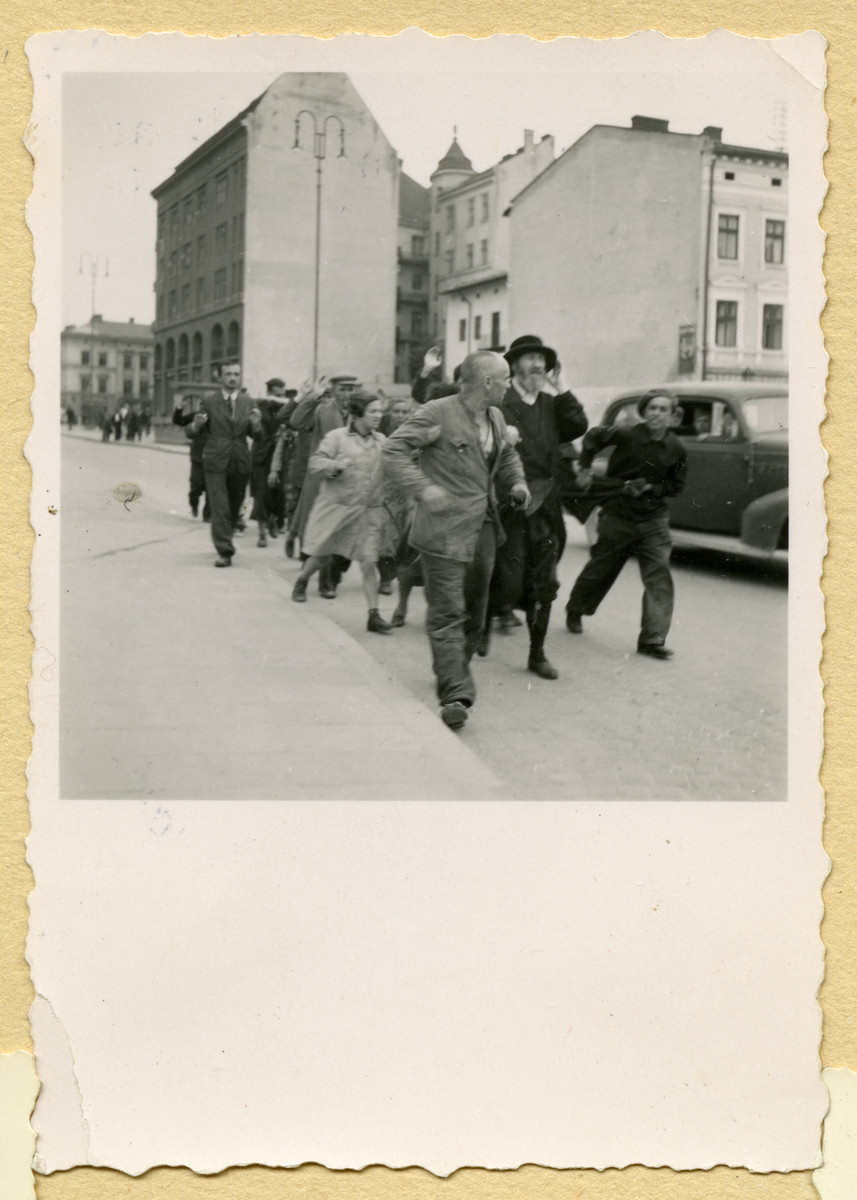 Jews as they are rounded up and marched down a street in Lvov.