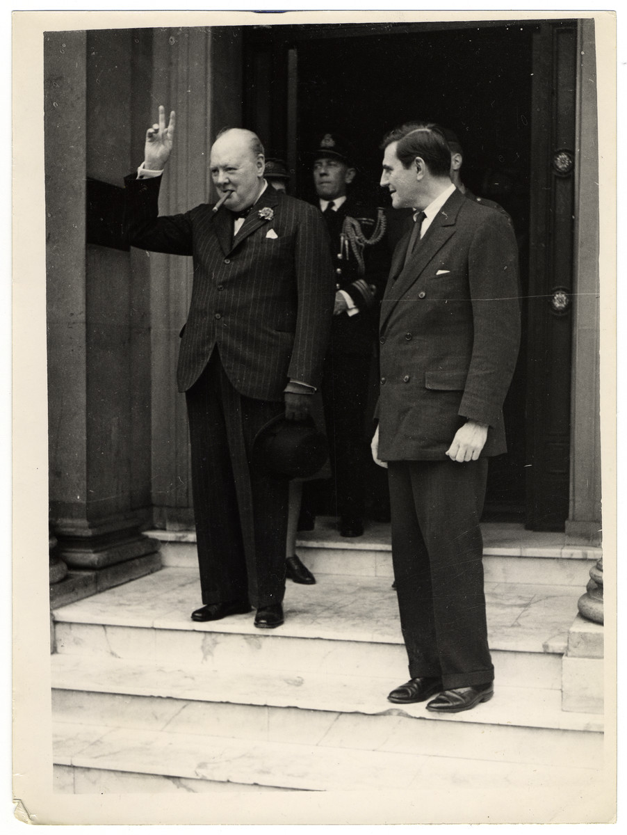 Winston Churchill  visits the American Ambassador, John Gilbert Winant, at the US Embassy, the day after the German surrender.