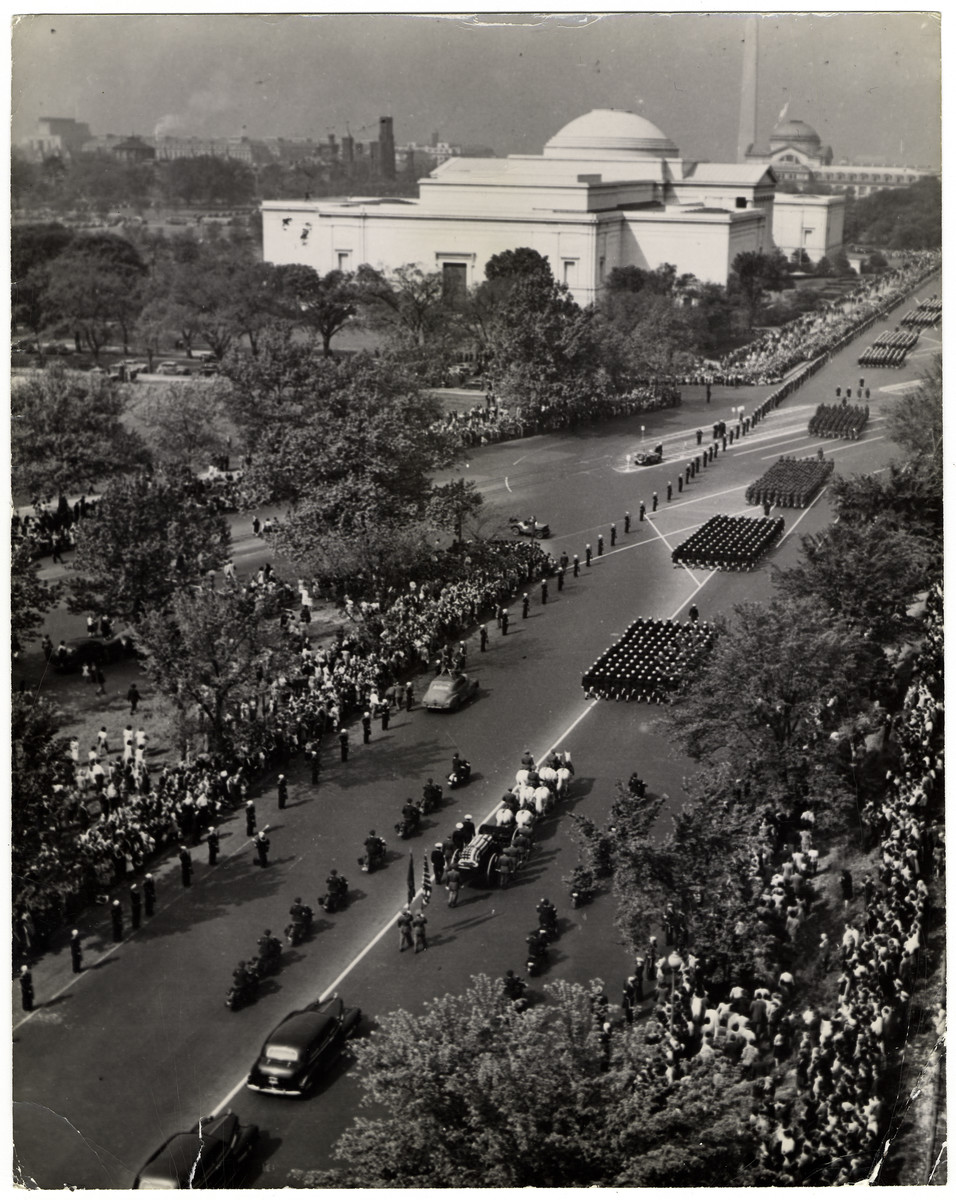 "Funeral procession for President Franklin D. Roosevelt.  The original caption read, ""The horse-drawn caisson bearing the body of the late U.S. President Franklin Delano Roosevelt, proceeds slowly up Constitution Avenue, past the National Gallery of Art in Washington, the U.S. Capitol, on April 14, 1945. Detachments representing the four branches of the U.S. armed forces lead the procession. At the White House, a simple service for the late President was held two days after the sudden death in Warm Springs. On April 15, the body of the great leader was interred in the garden of the ancestral Hyde Park estate in the eastern U.S. State of New York."""
