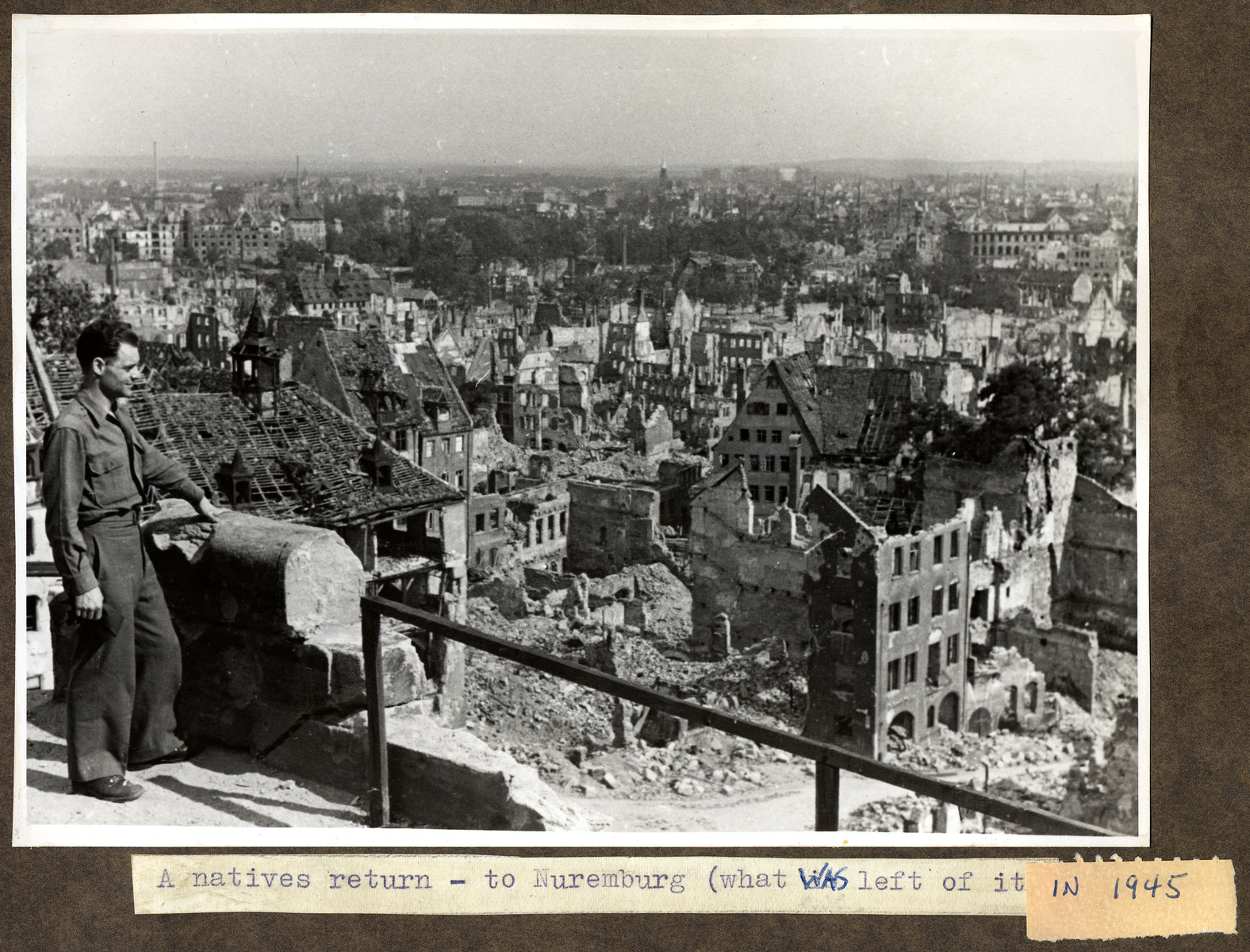 Joseph Eaton, an American solder who had been a German-Jewish refugee, surveys the bombed-out remains of Nuremberg, his hometown.