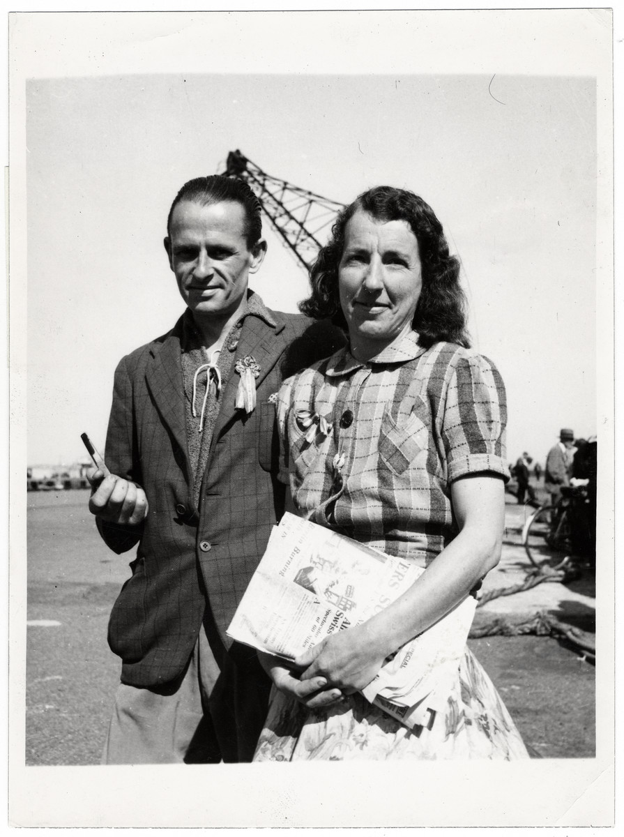 "Portrait of a British couple from the Channel Islands who were imprisoned for expressing anti-Nazi beliefs.  Original Caption: ""Mr. and Mrs. Winifred Green of 'Psycho-Sarchers', St. Peters Port, Guernsey. During the occupation Mr.Winifred Green was waitress in the Royal Hotel, and it was her job to serve the German Officers.  On one occasion the Germans after having held a conference gave the usual 'Heil Hitler' salute. Immediately Mrs. Winifred Green retaliated by retorting 'Heil Churchill.' She was clapped into jail for six months imprisonment."""