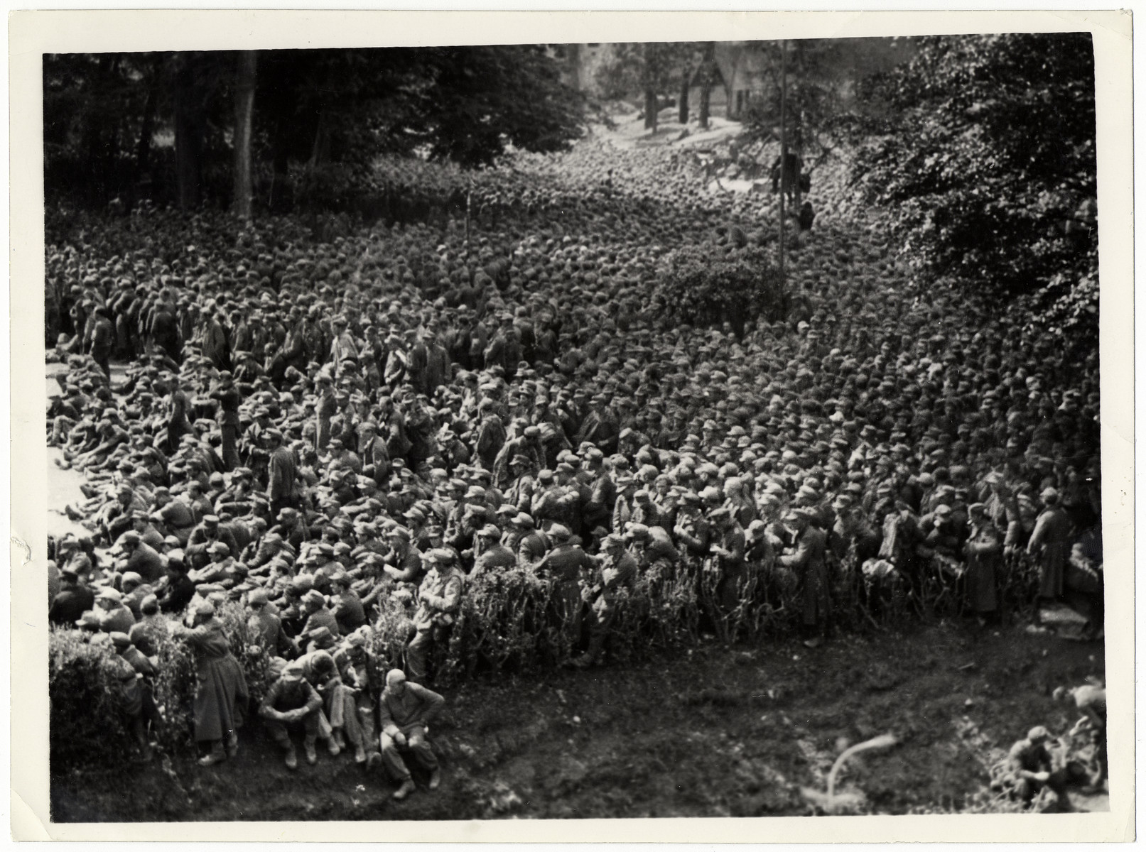 Thousands of German prisoners crowd into the 5th Army POW cage at Vicenza, Italy.