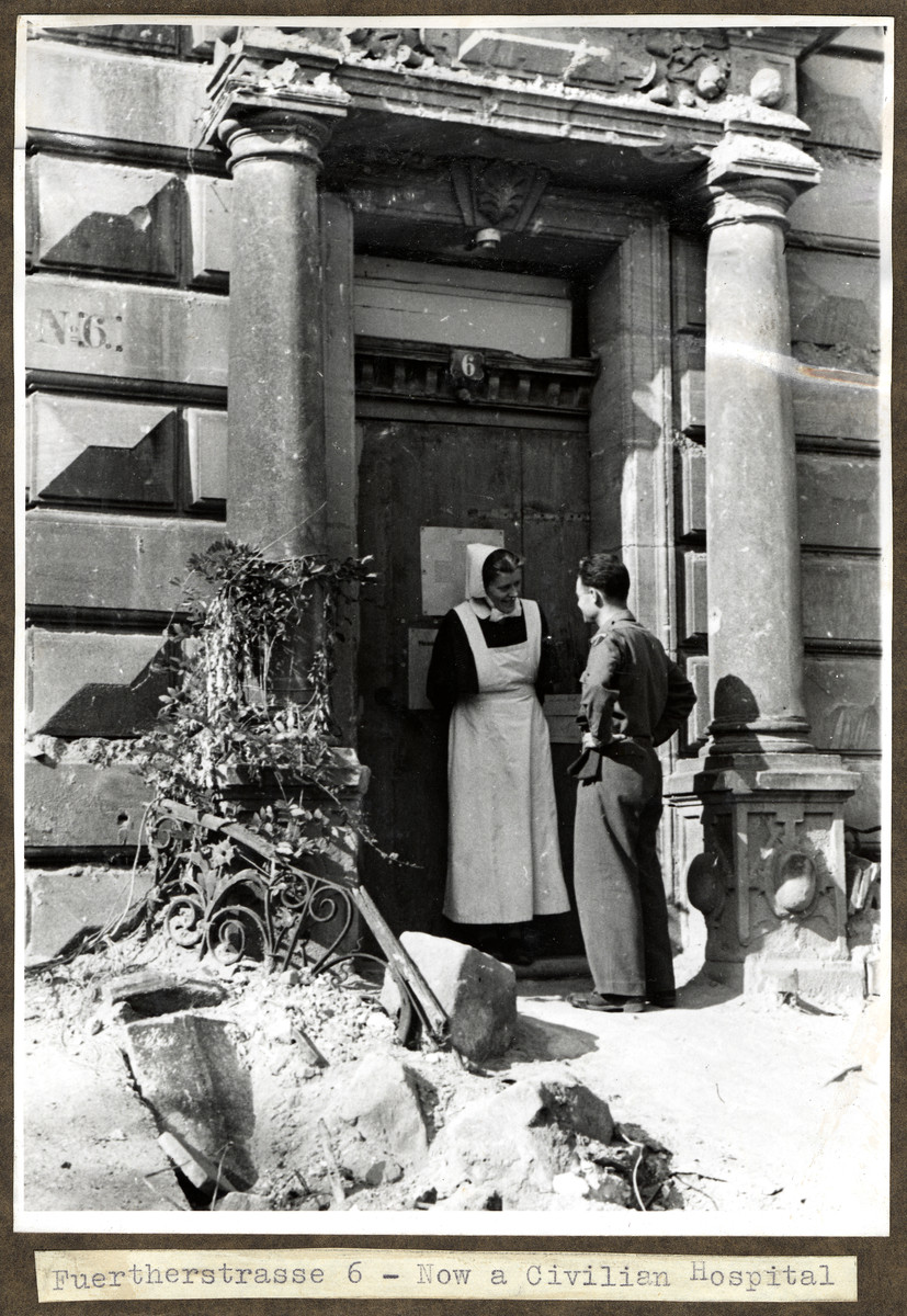 Joseph Eaton talks to a nurse at his childhood home, Fuerherstrasse 6 in Nuremberg, which became a civilian hospital.